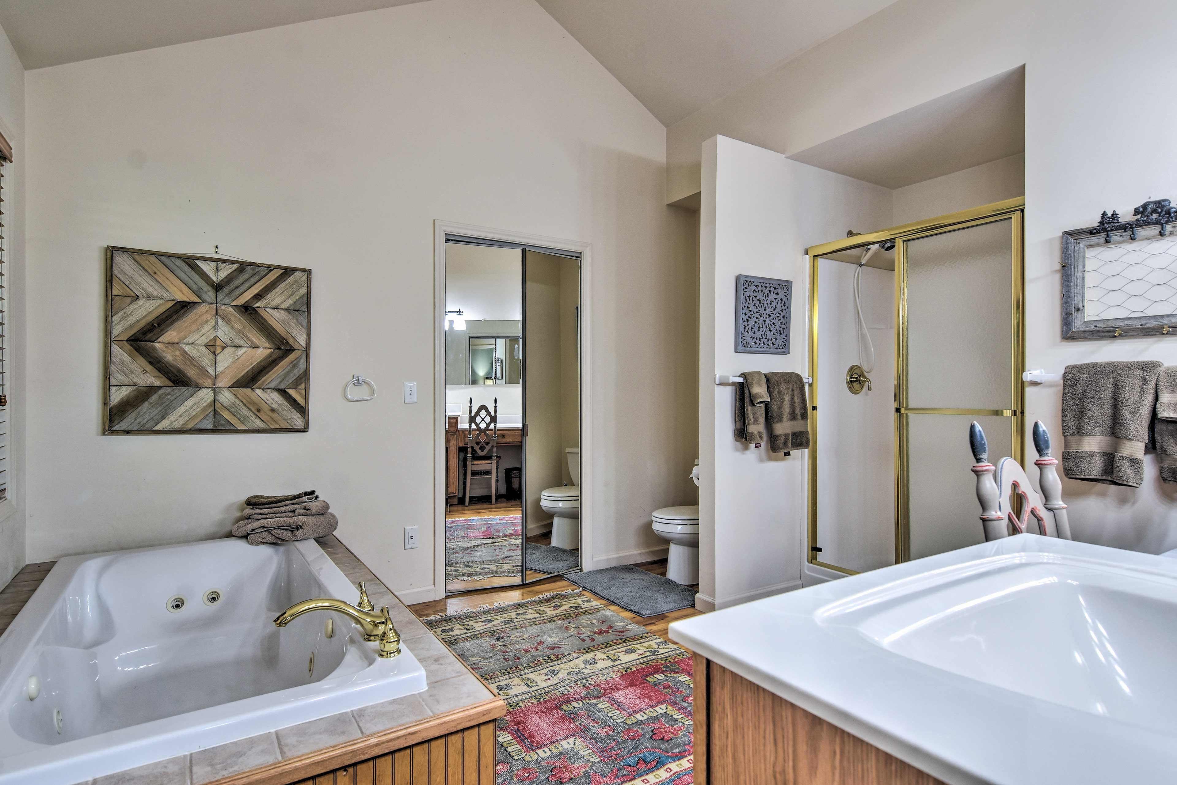 The master bath features a walk-in shower, soaking tub and Jack-and-Jill sinks.