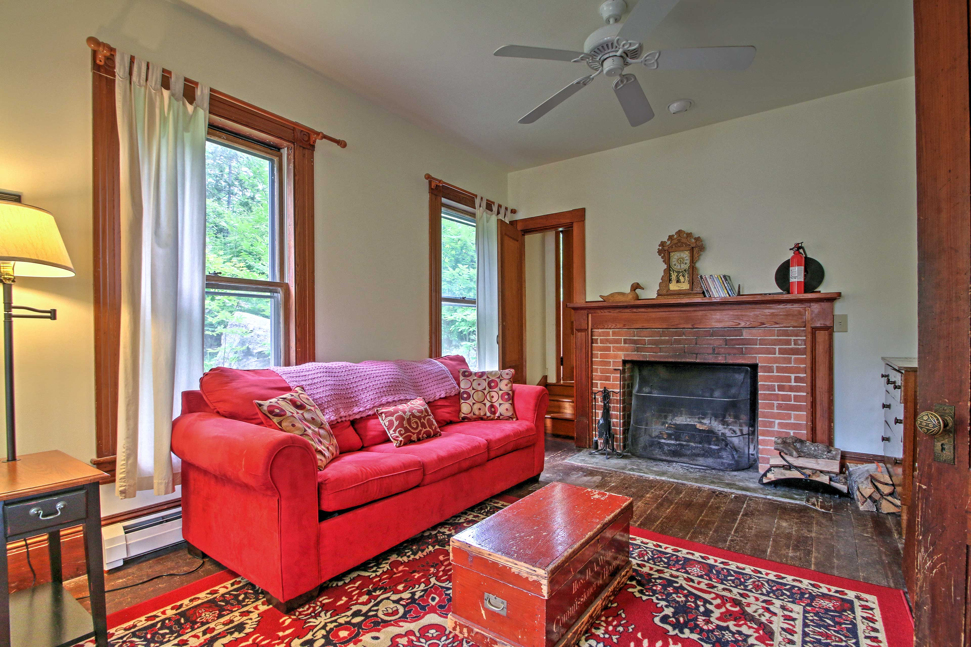 Relax by the fireplace in this lovely sitting room.