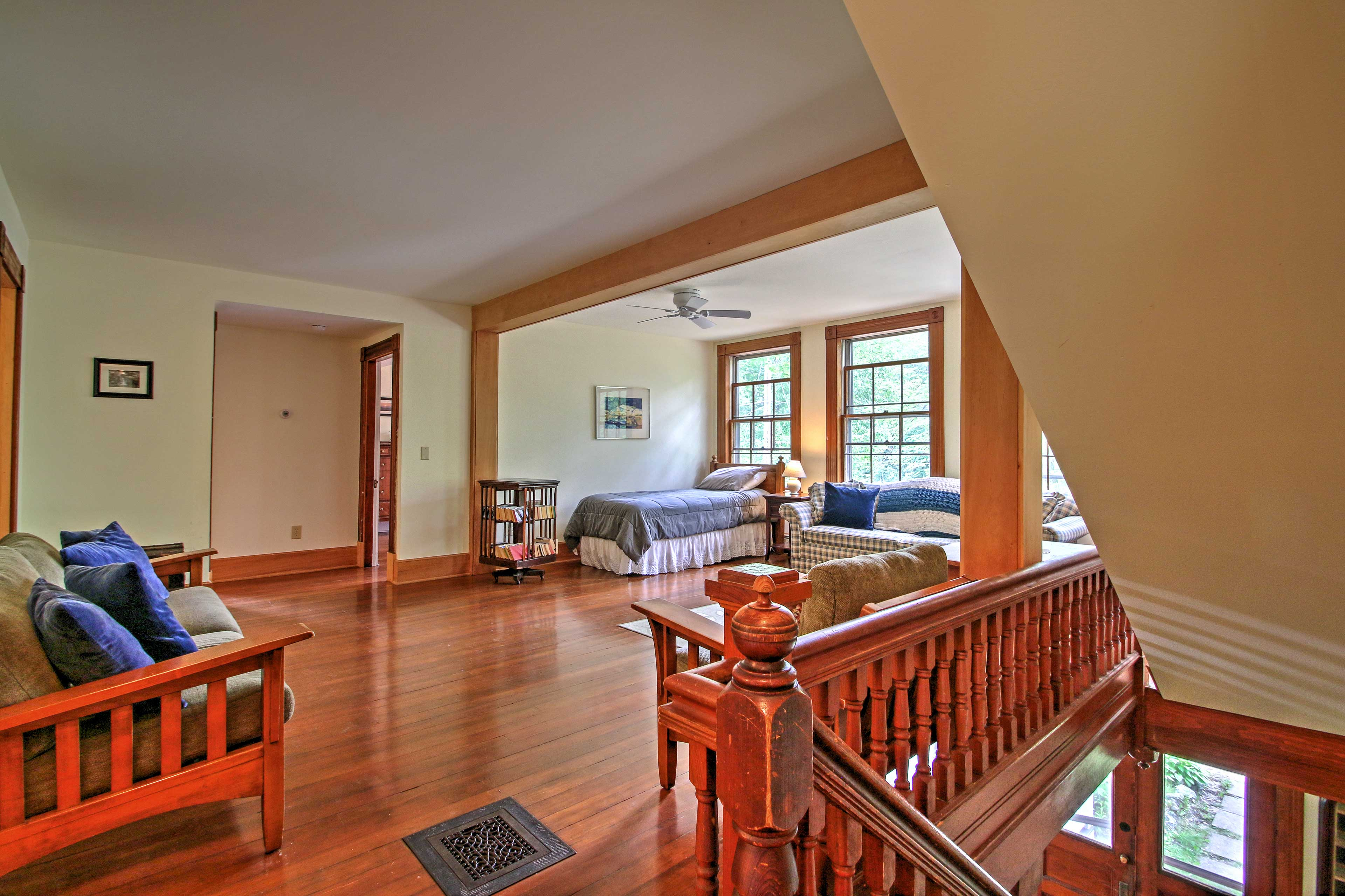 On the second floor is a wide open room with a futon, sofa, and twin bed.