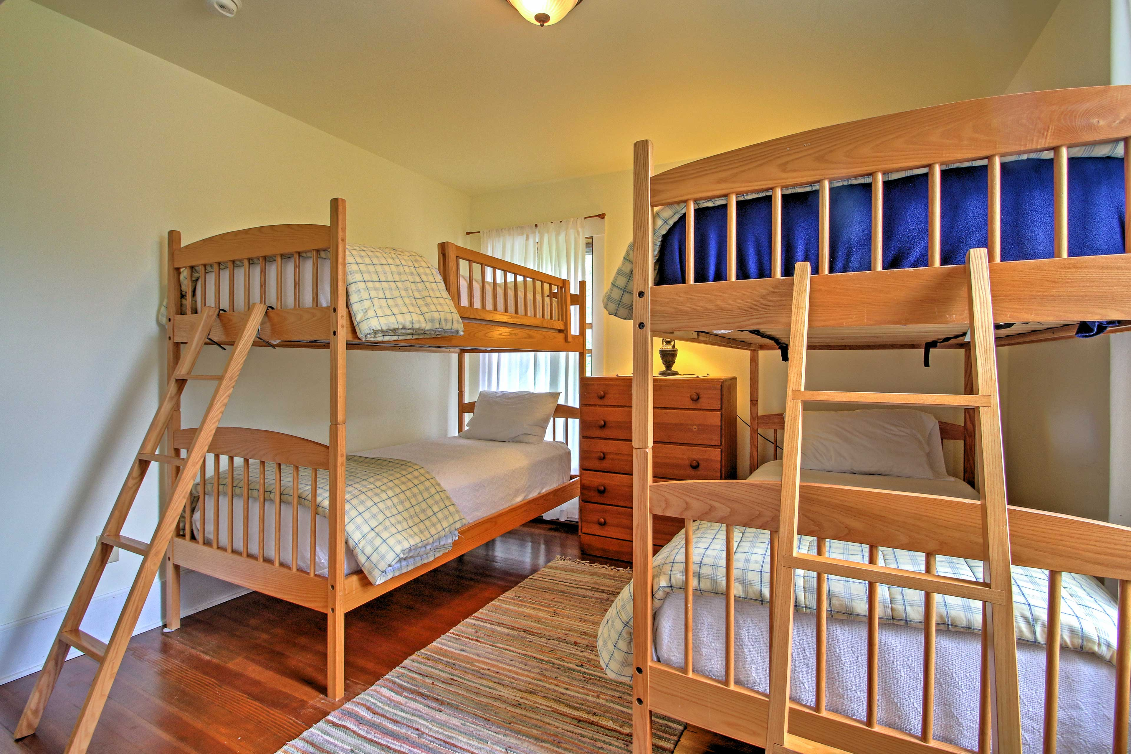 The twin-over-twin bunk beds in this room are fun for kids!