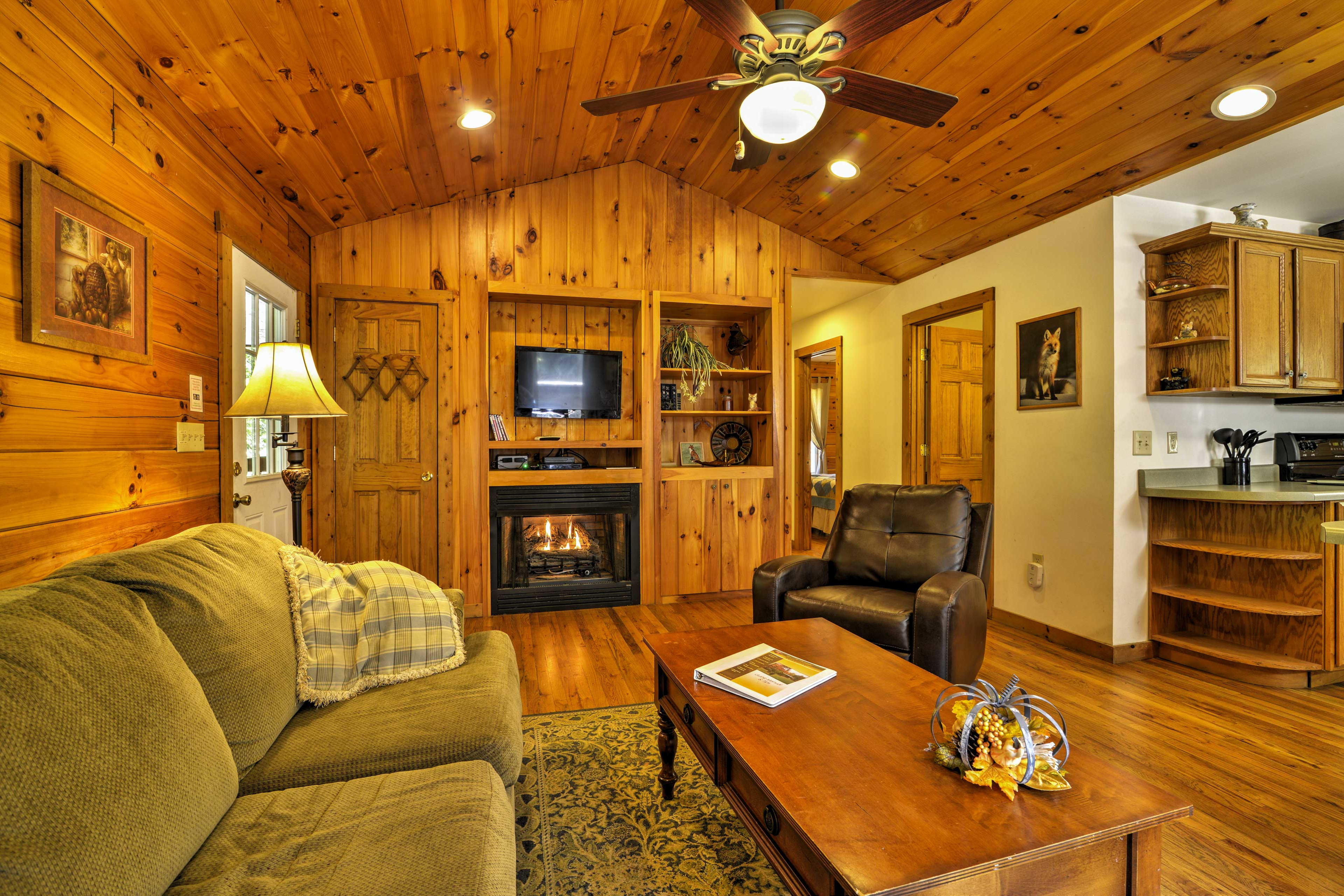 The cabin features an all-wood interior with a traditional cabin atmosphere.