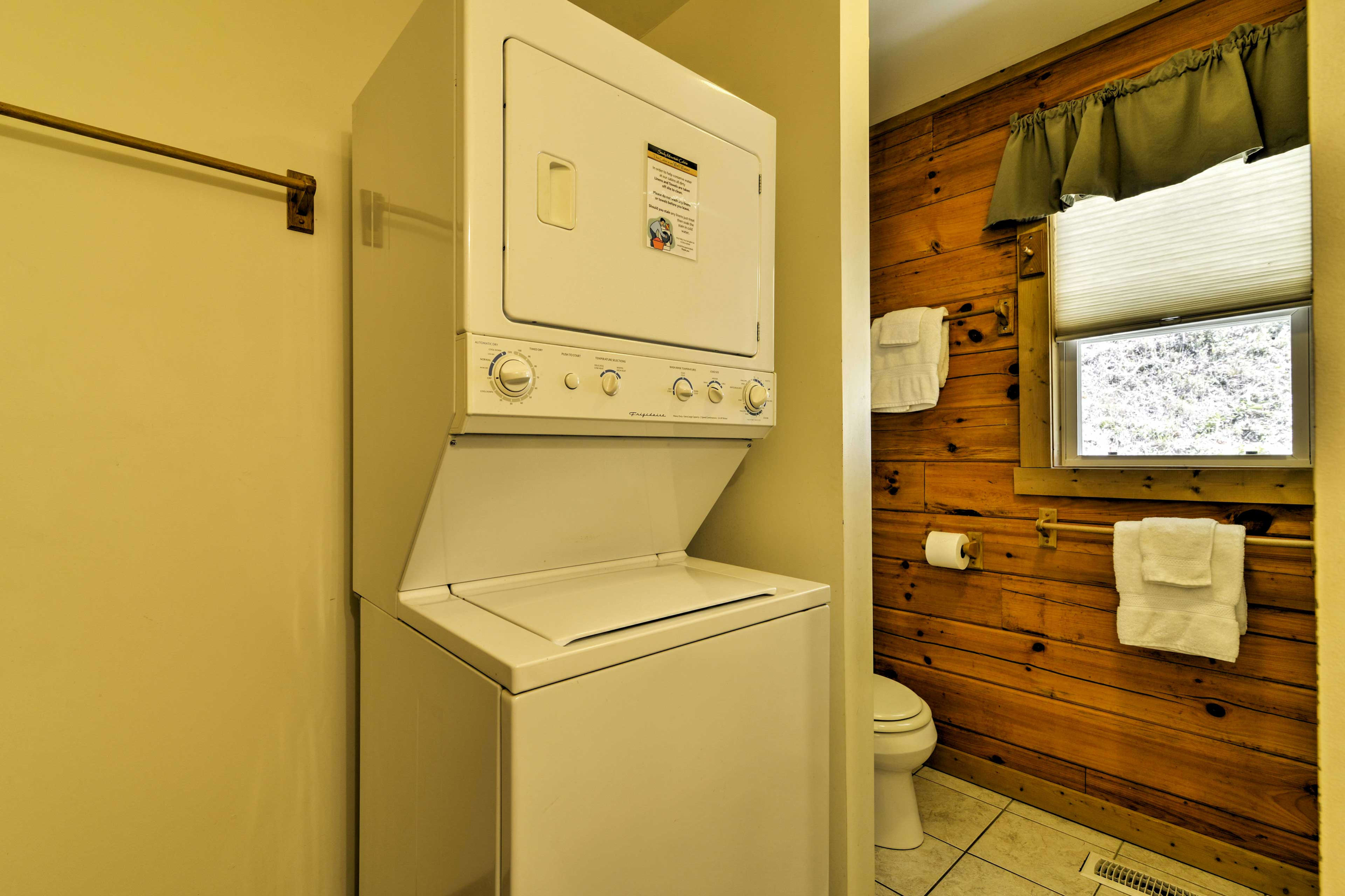 The bathroom includes the laundry machines.