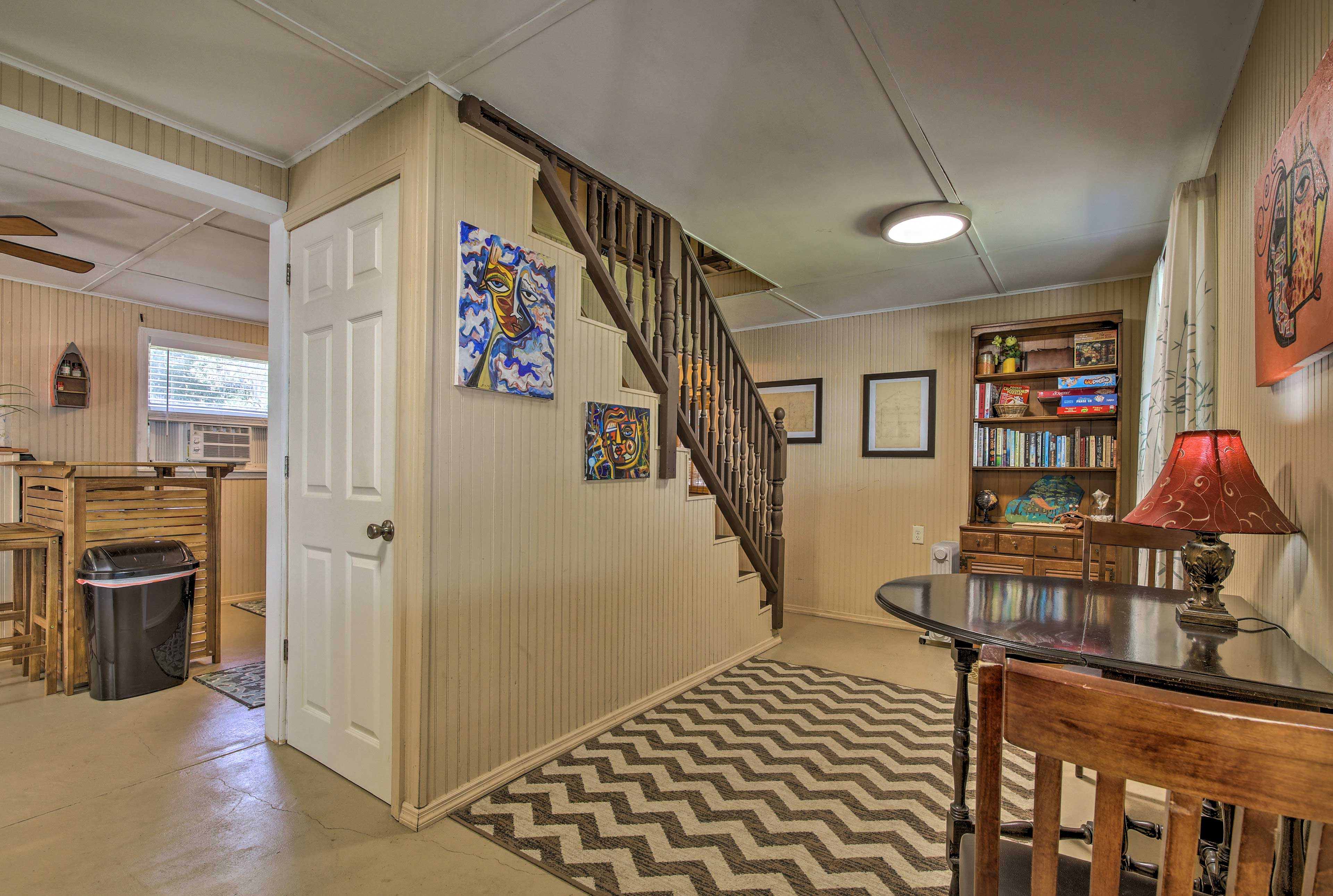 Head upstairs to access the bedroom.