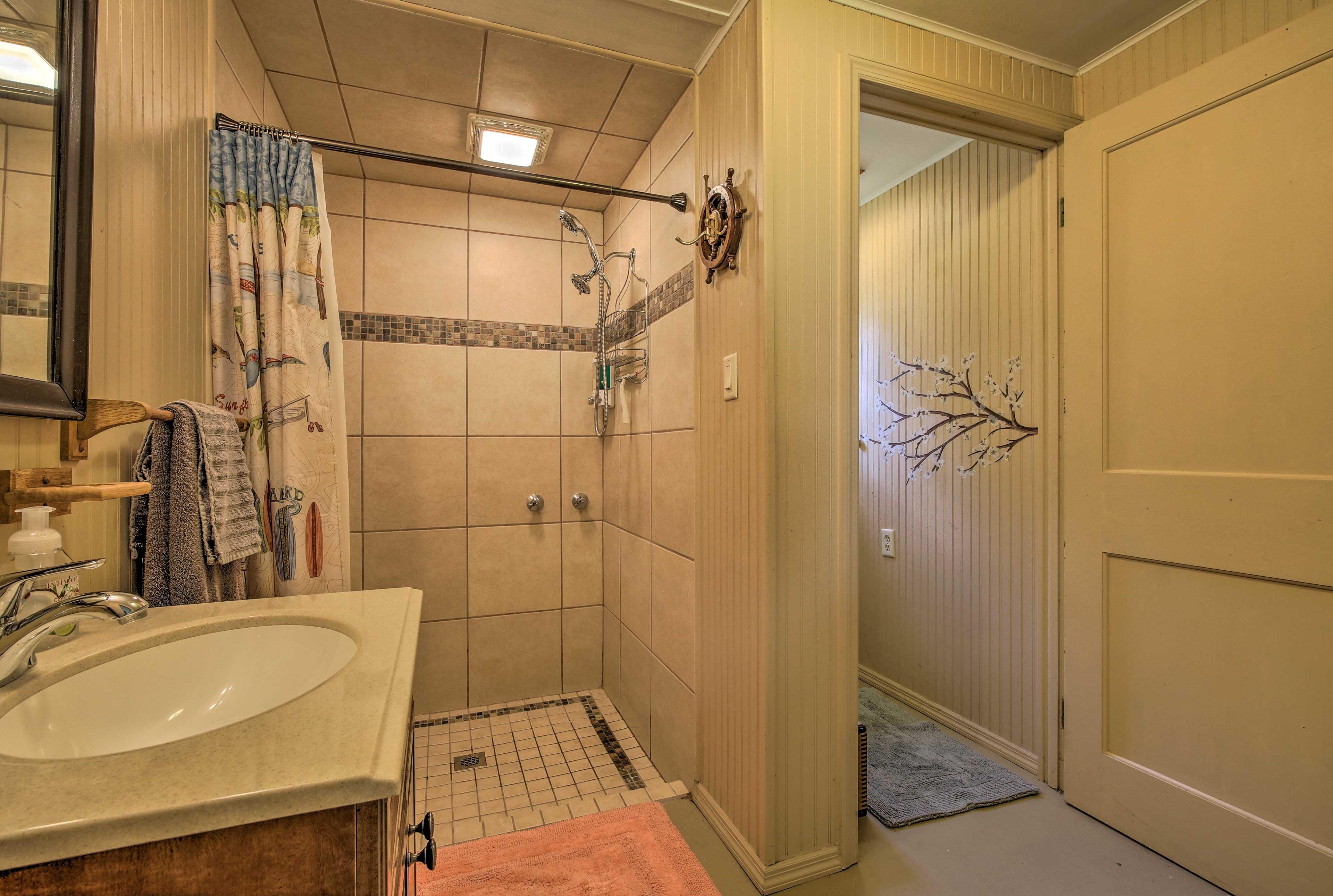 The full bathroom has a walk-in shower.