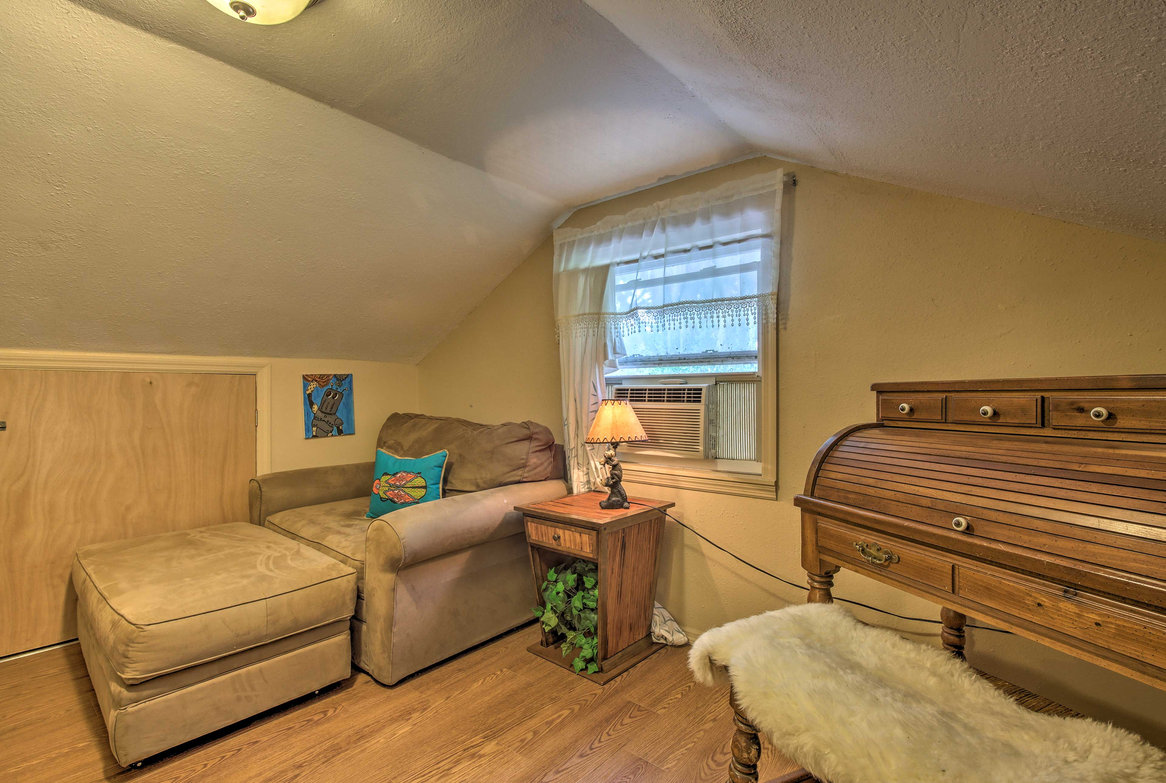 The kid's room upstairs features a plush couch that also pulls out into a bed.