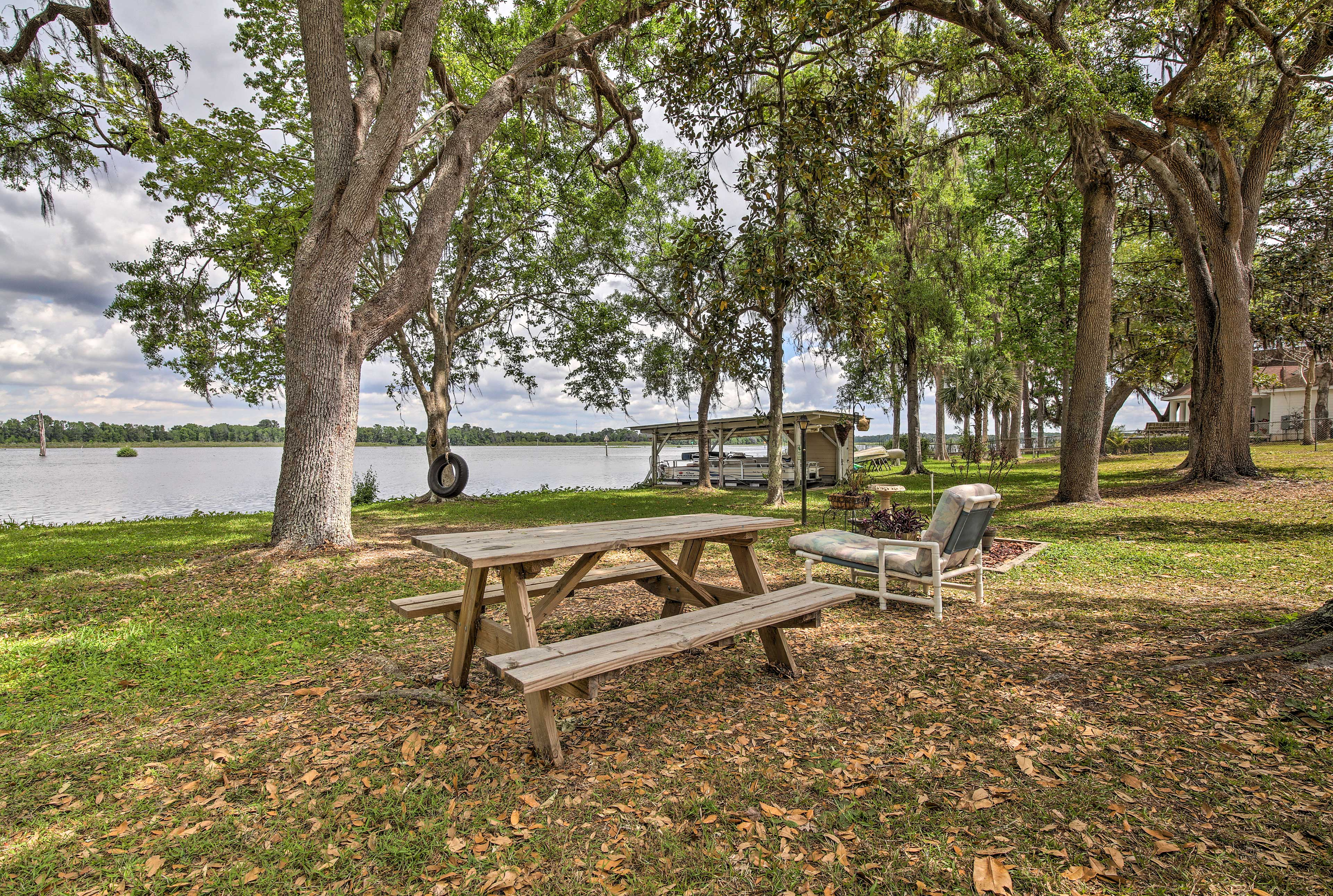 The peaceful property is well-manicured and boasts a boat house!