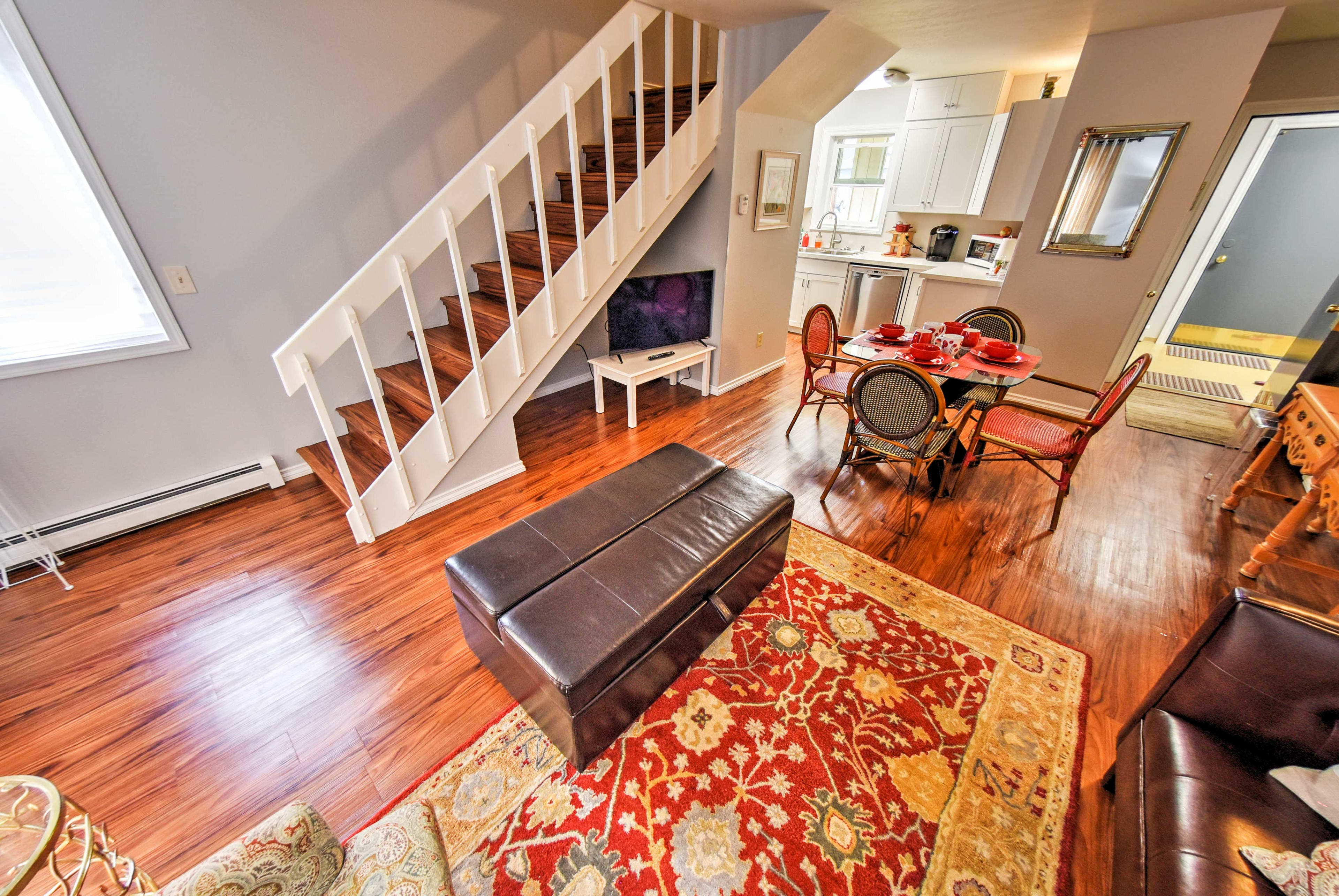 Follow the stairs to access the home's bedrooms.