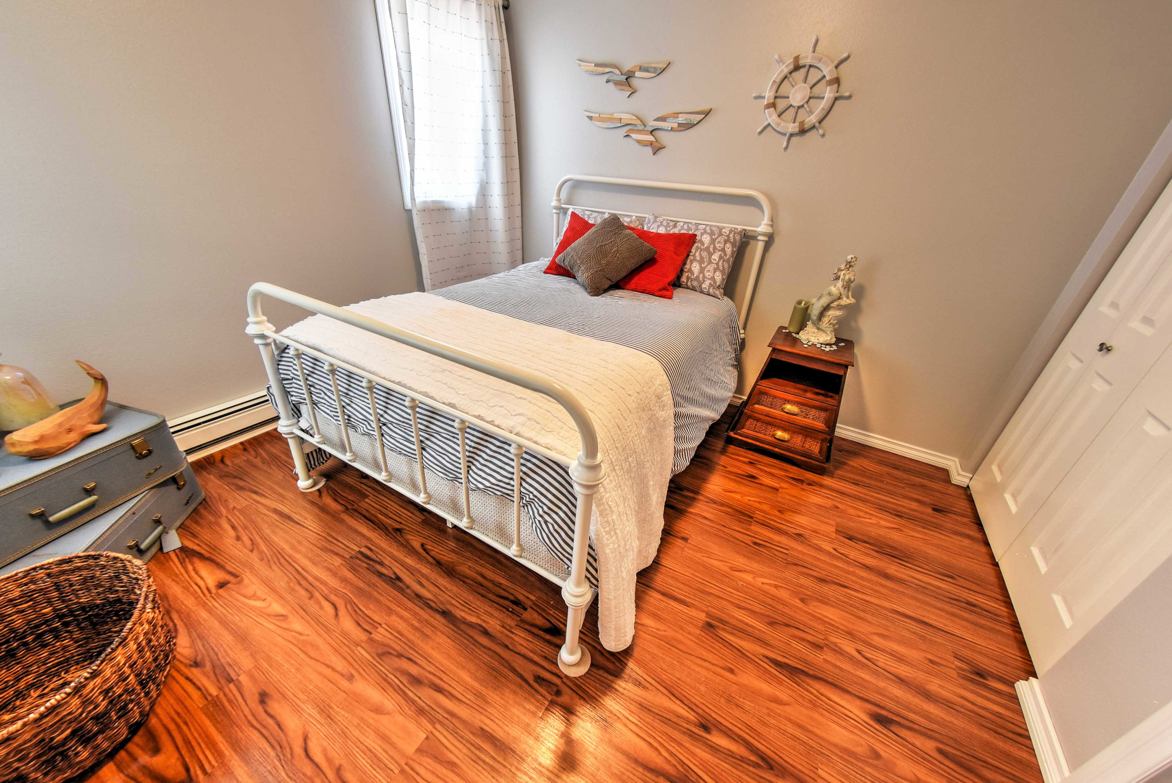 This bedroom features a full-sized bed to sleep 2 guests.