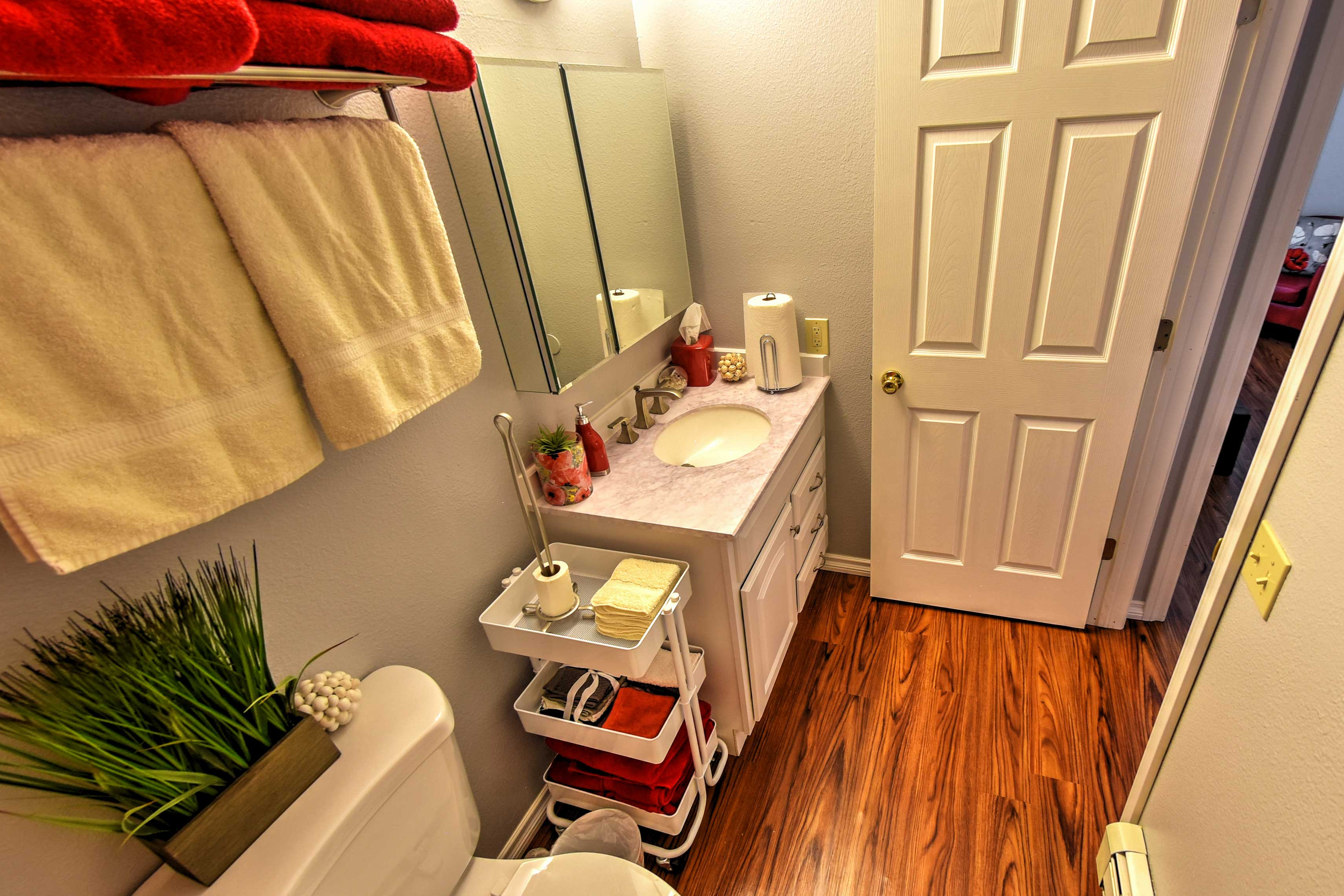 Get ready each morning at the mirrored vanity.