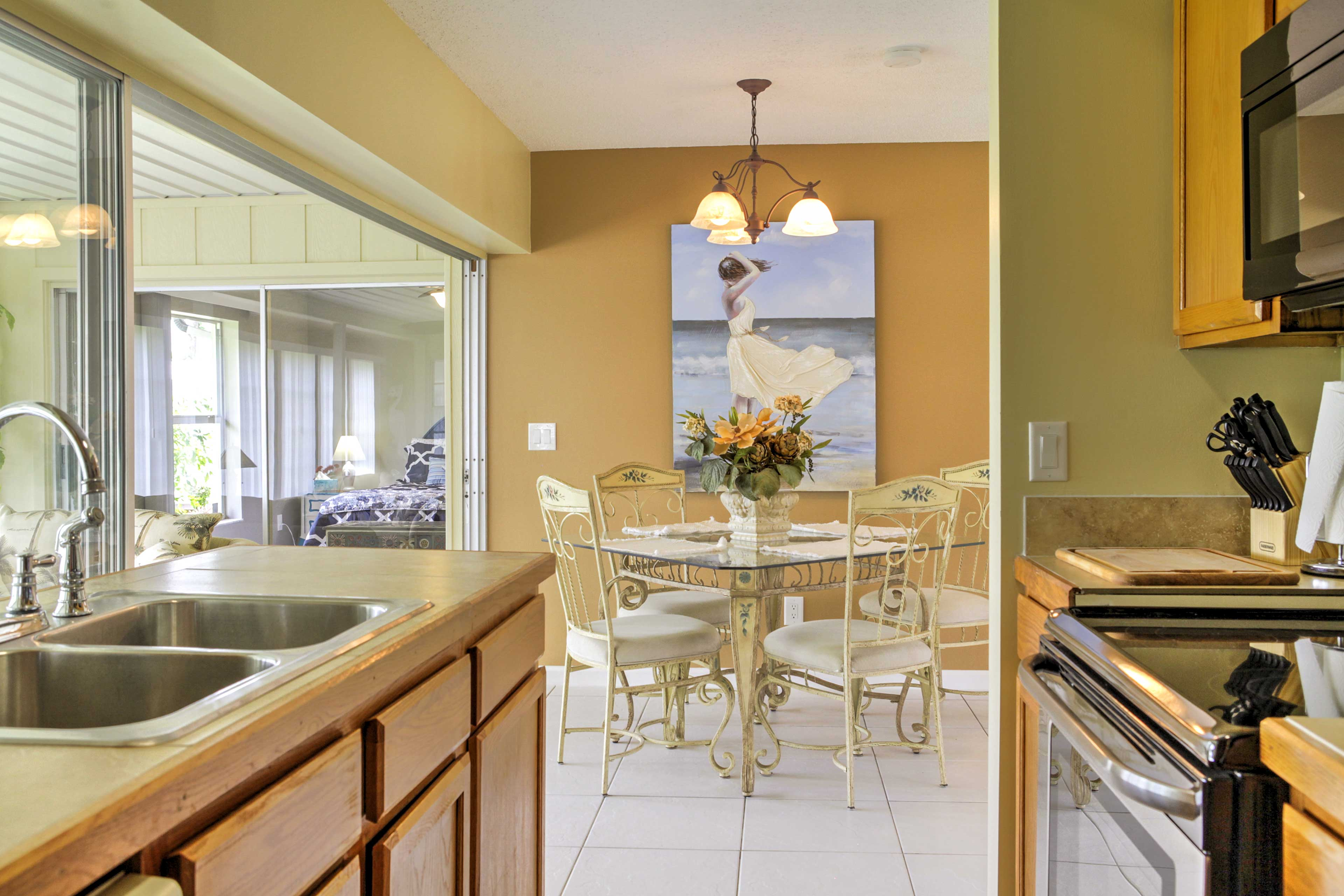 The dining area opens up into the kitchen.