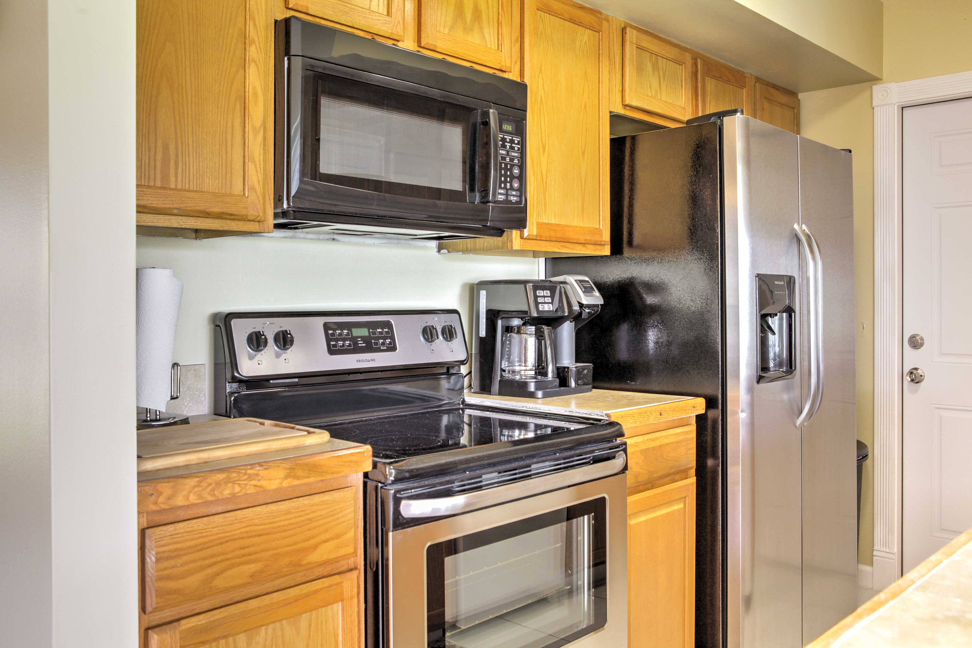The kitchen offers new stainless steel appliances.