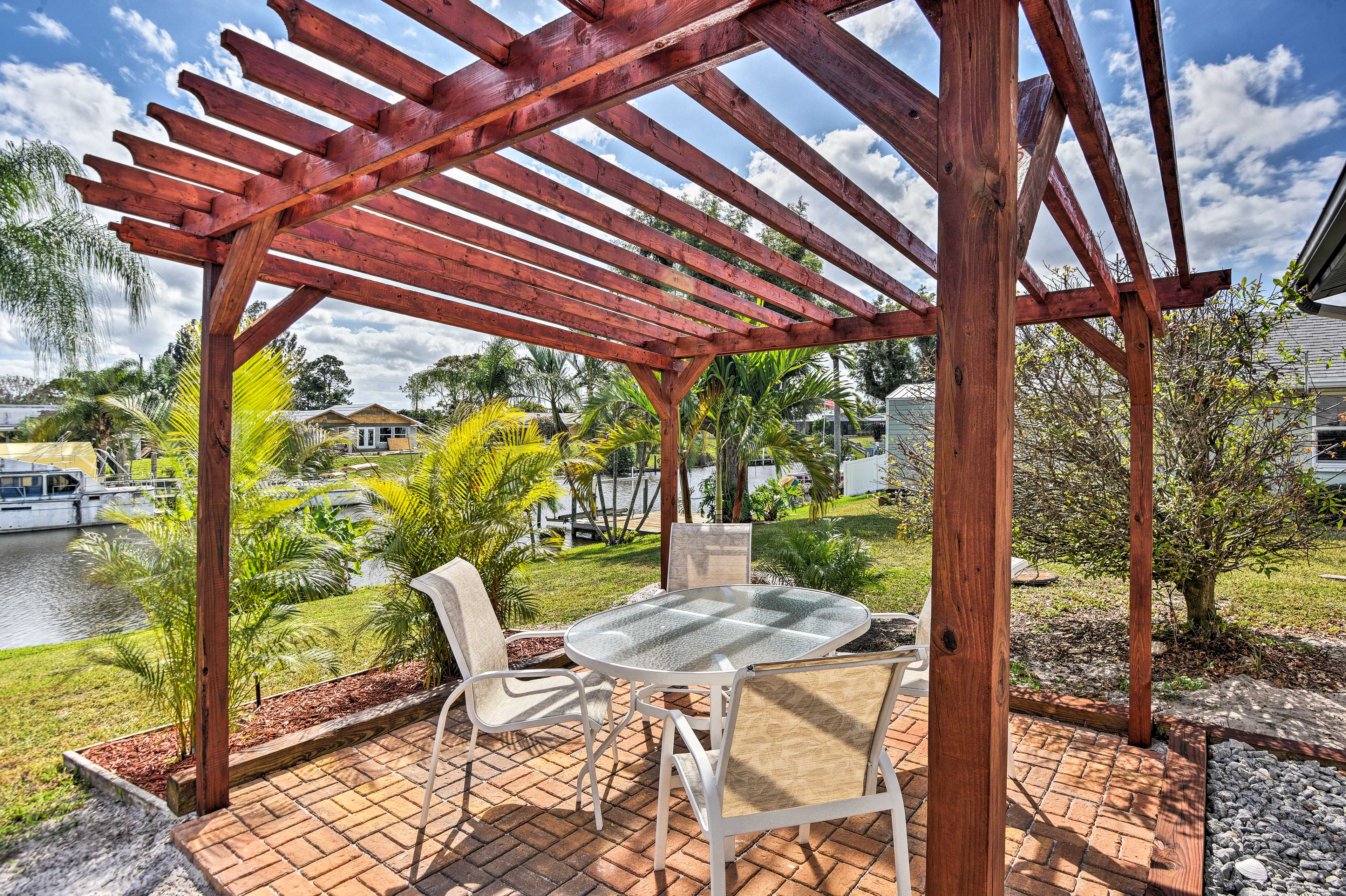 Enjoy a cocktail beneath the pergola while watching the sunset.