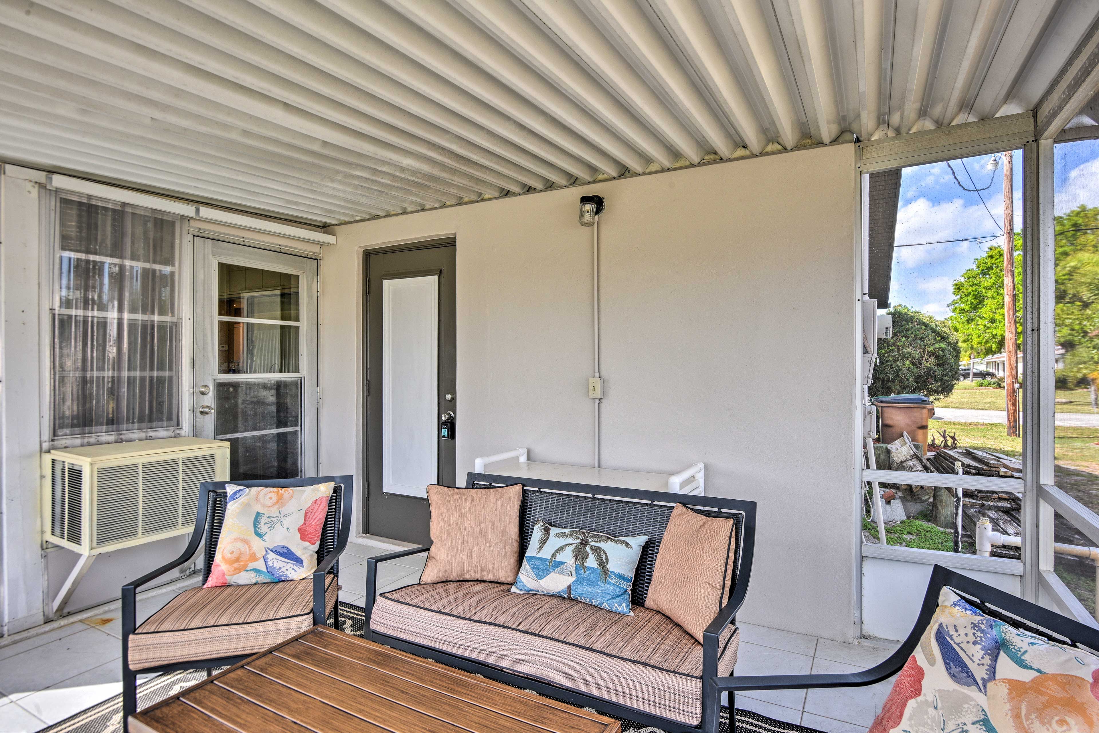 The enclosed porch is the perfect place to enjoy your morning cup of joe!