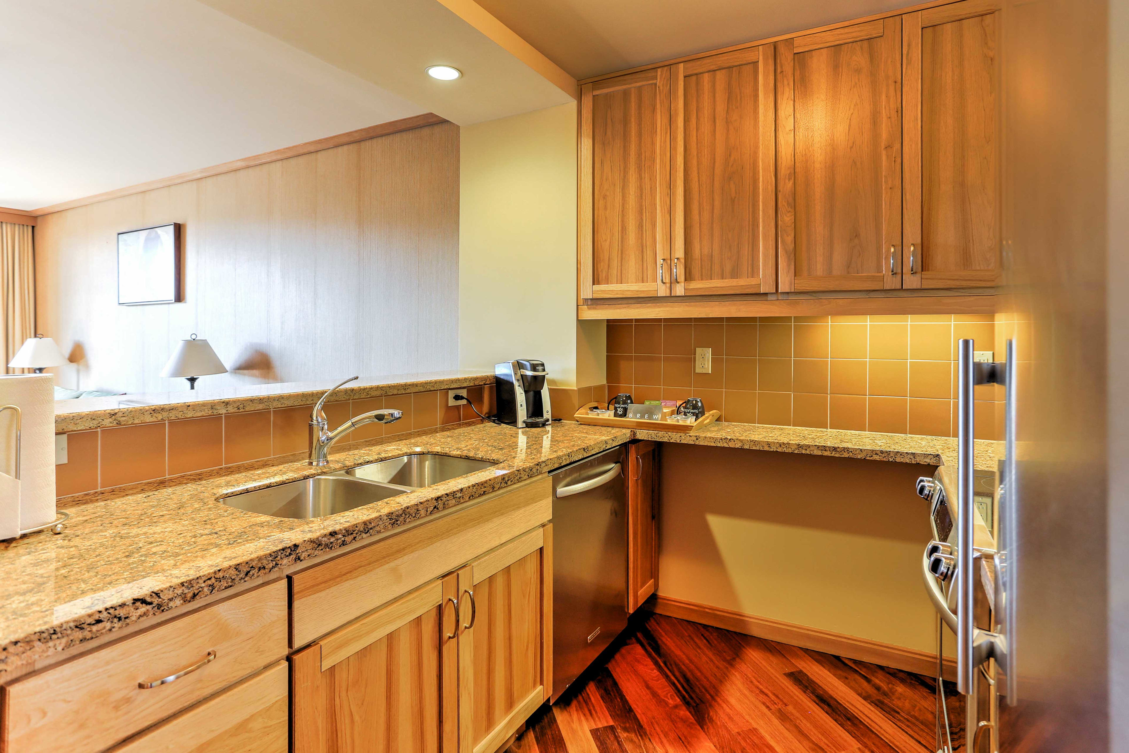The kitchen opens into the living room through a breakfast bar.
