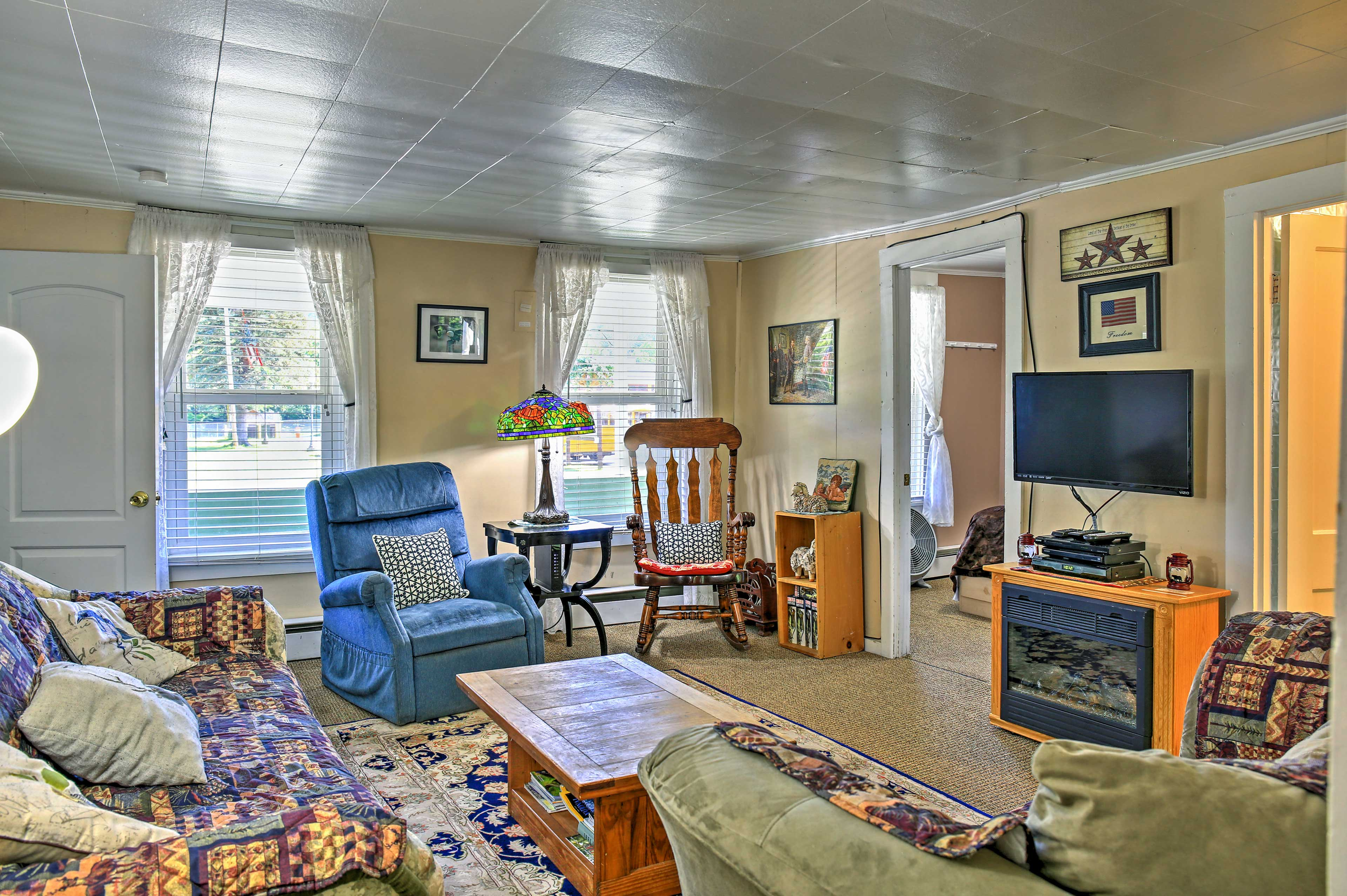 Unwind in the living room next to the electric fireplace and enjoy movie night with the group.