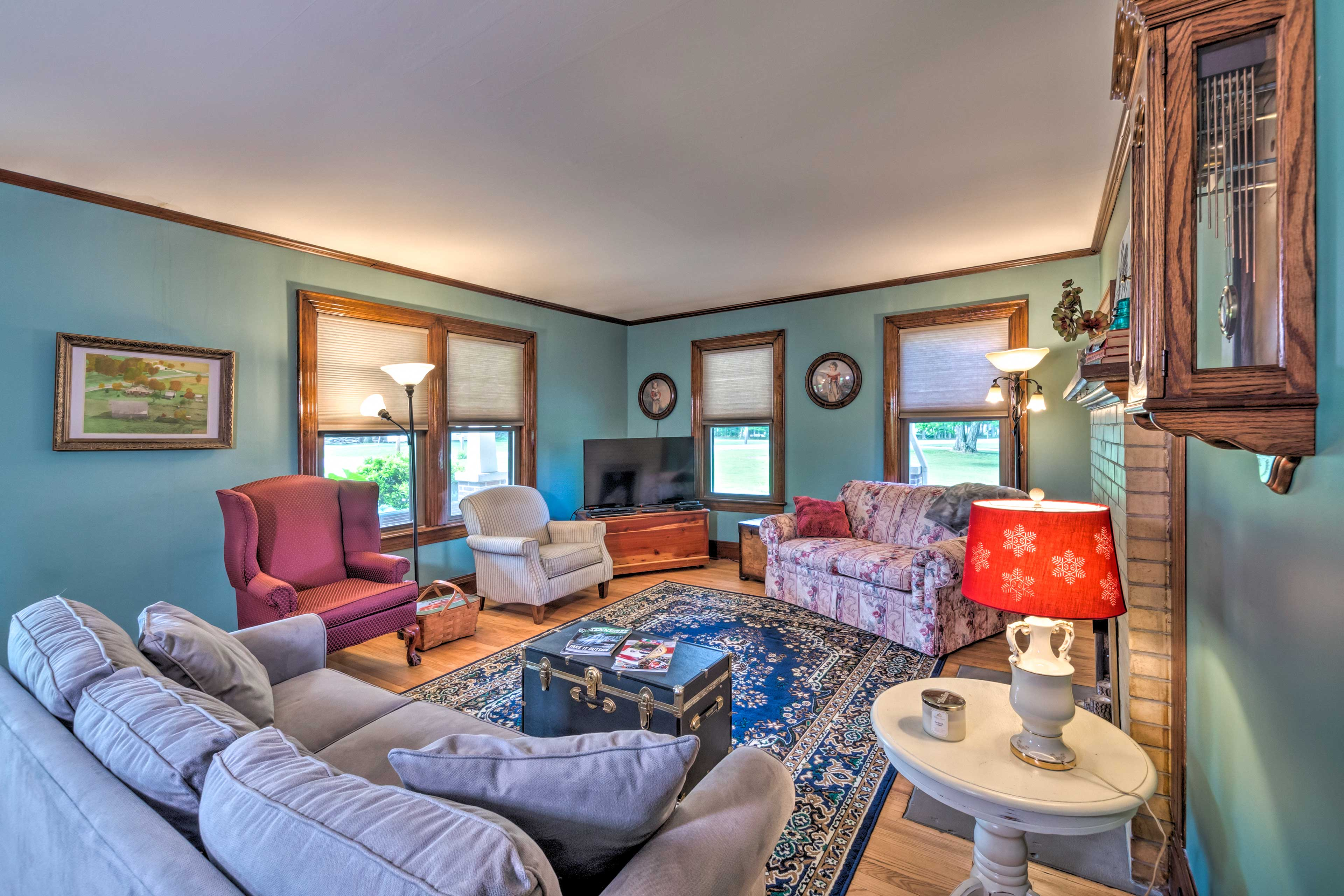 Watch movies on the flat-screen TV while relaxing on the colorful couches.