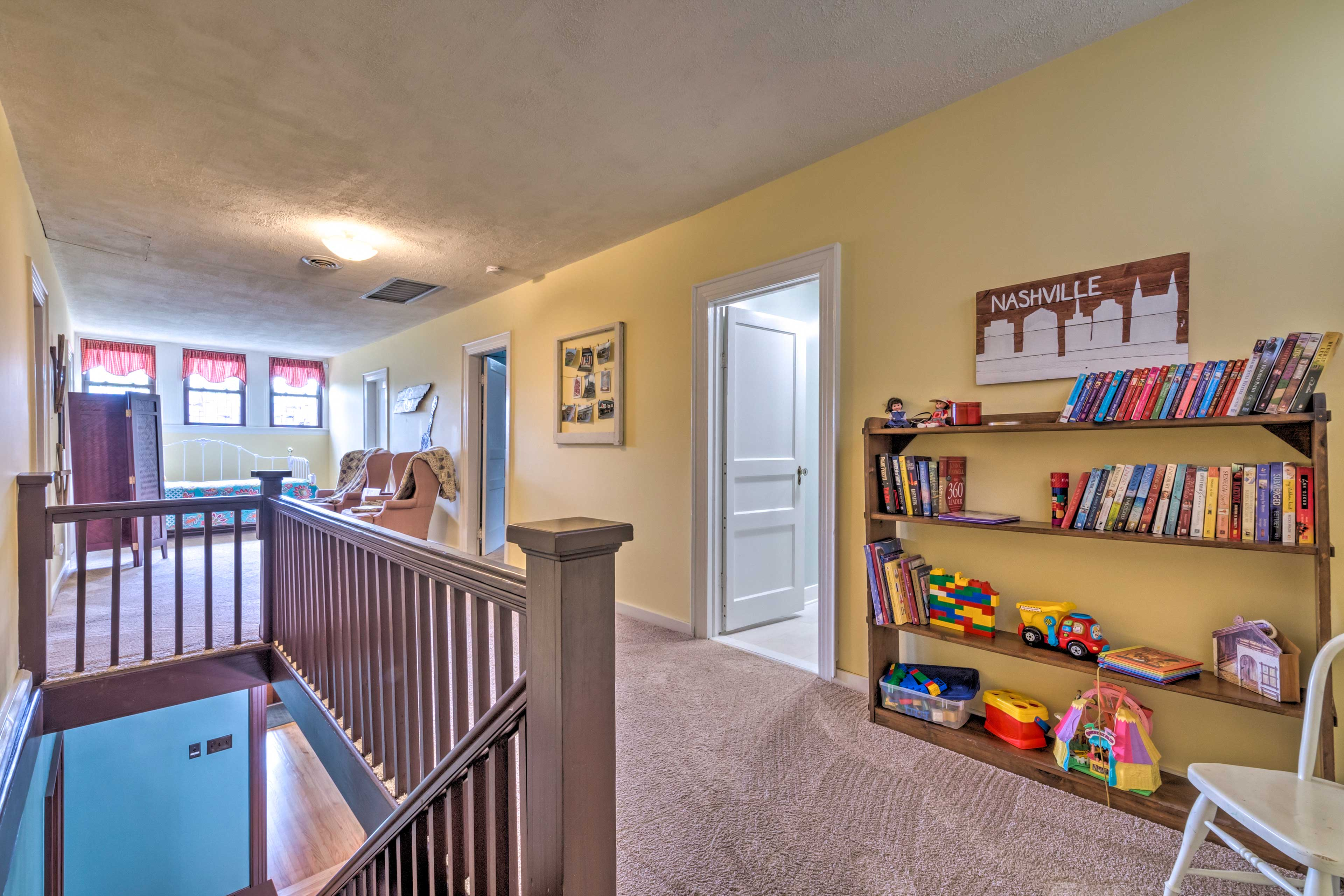 Head upstairs to find more bedrooms and a book shelf!