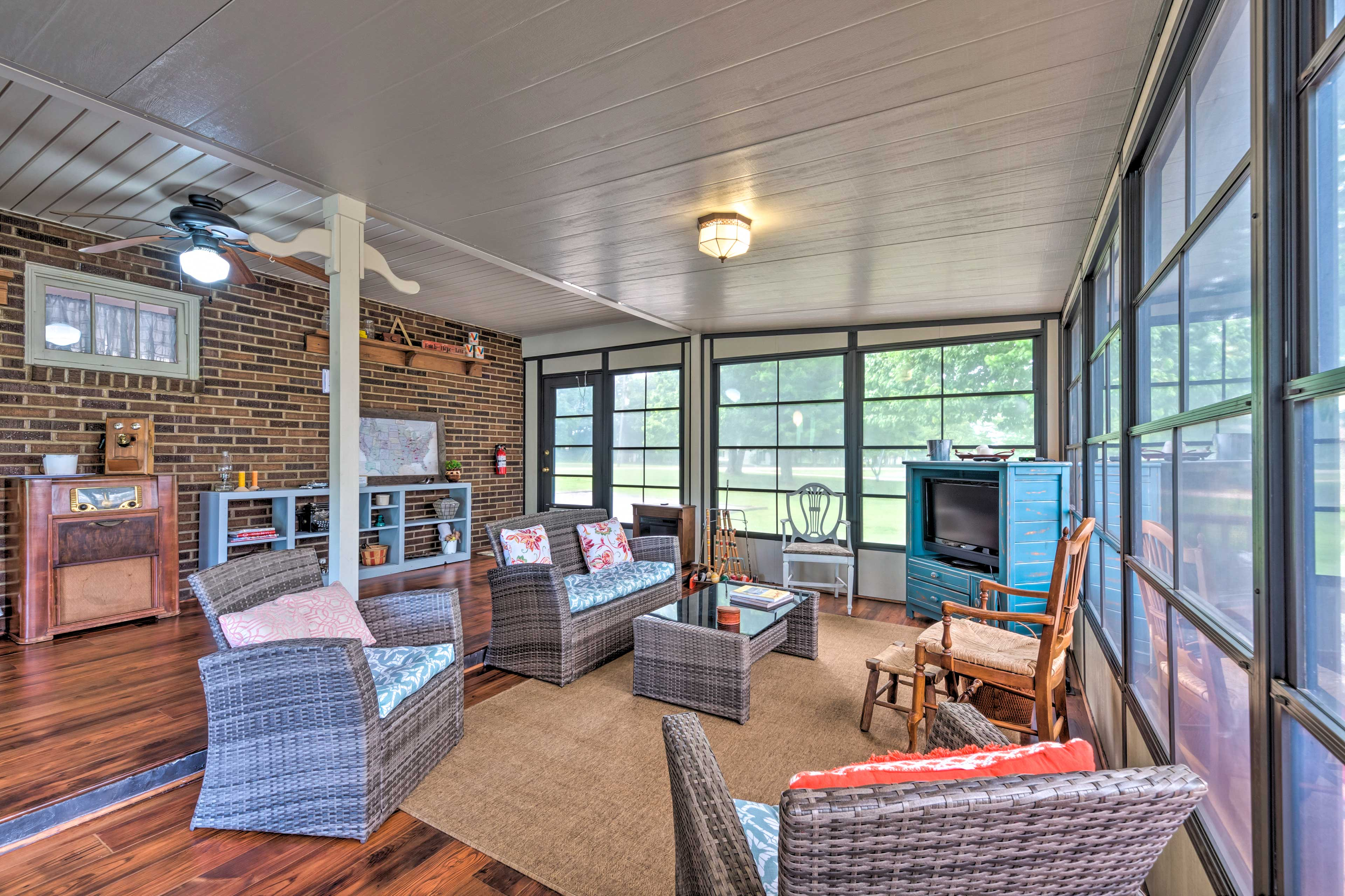 Enjoy relaxing evenings watching movies in the sunroom.