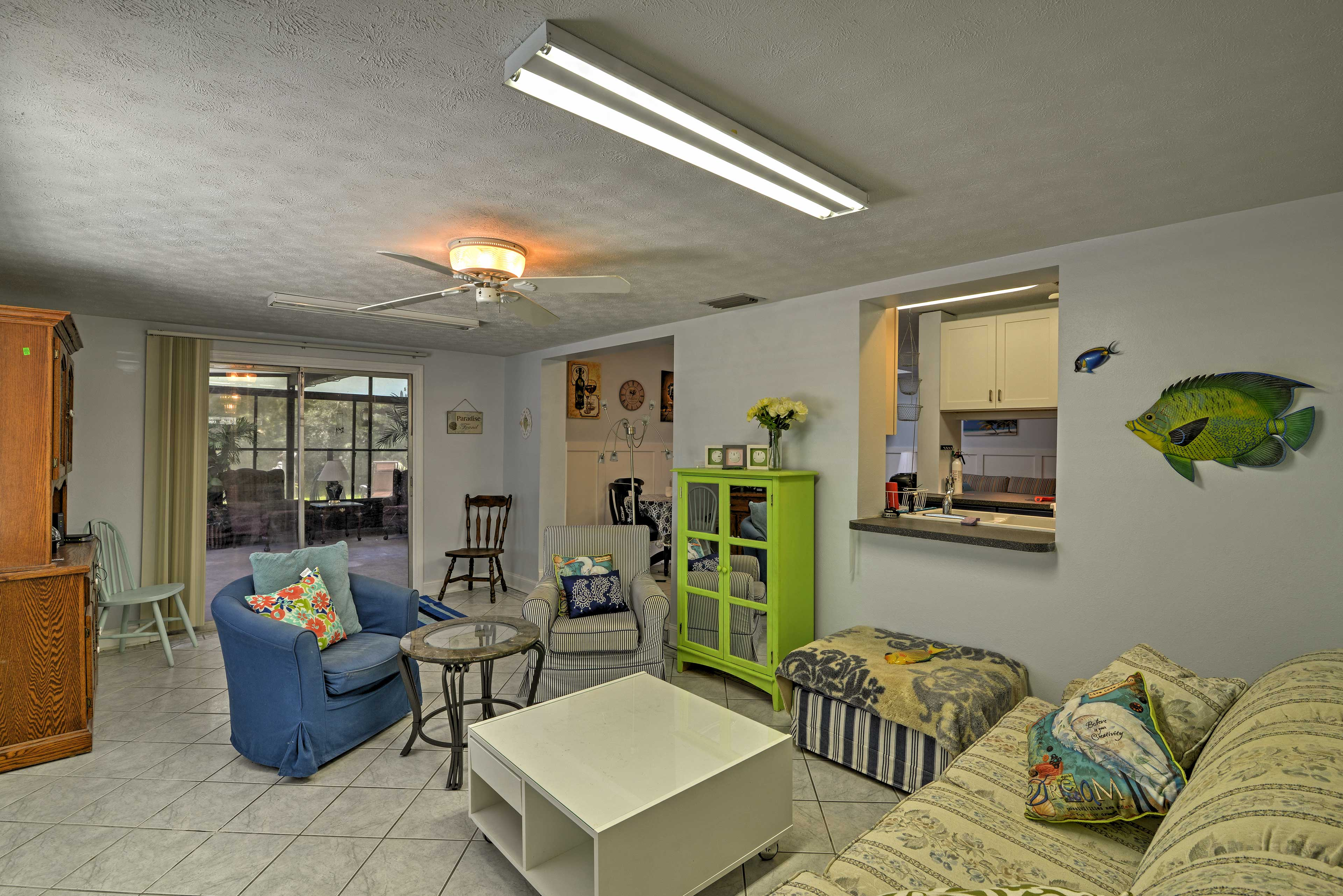 Step into the beach themed sitting room with a couch and 2 armchairs.