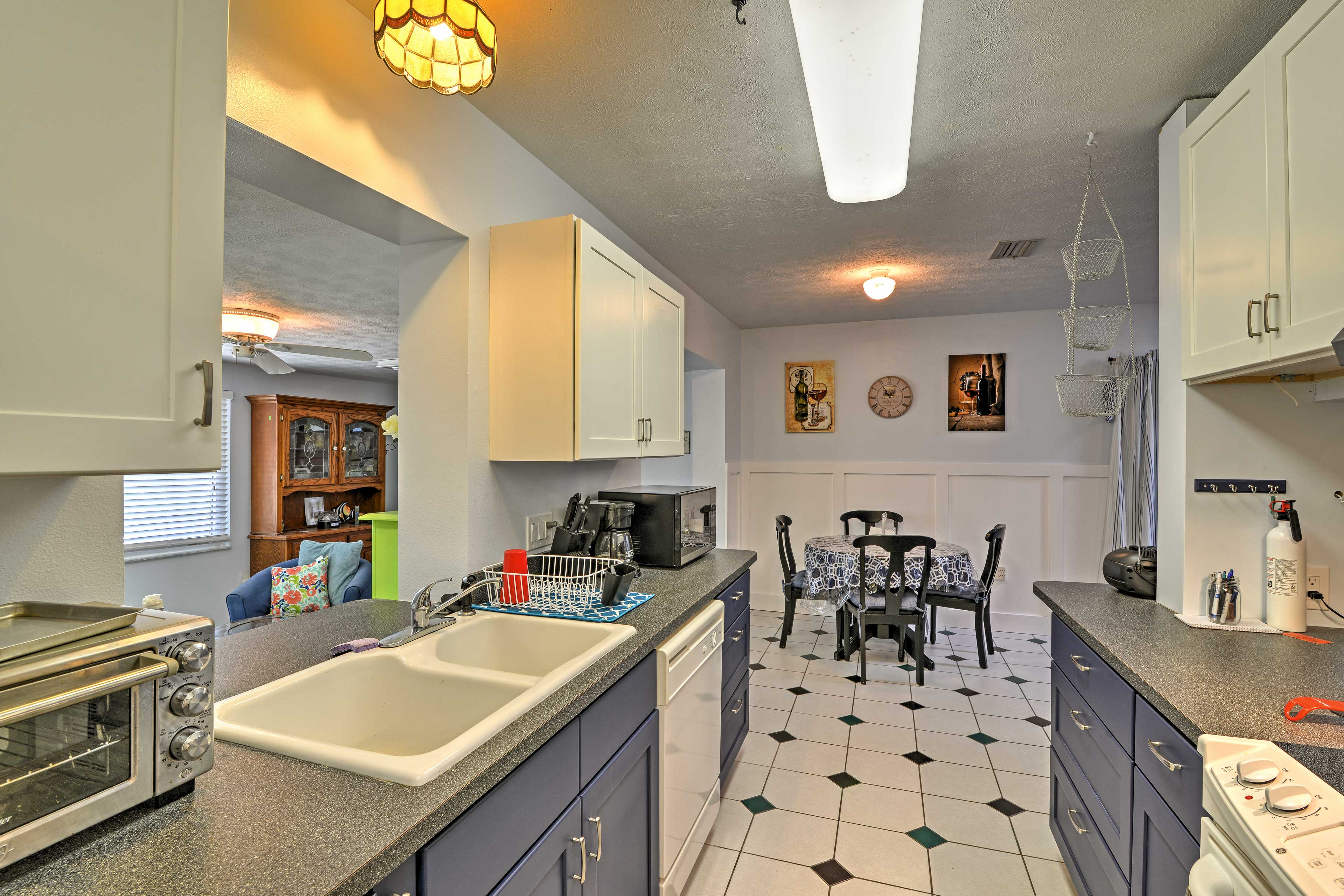 The galley style, full kitchen offers modern appliances and tile floors.