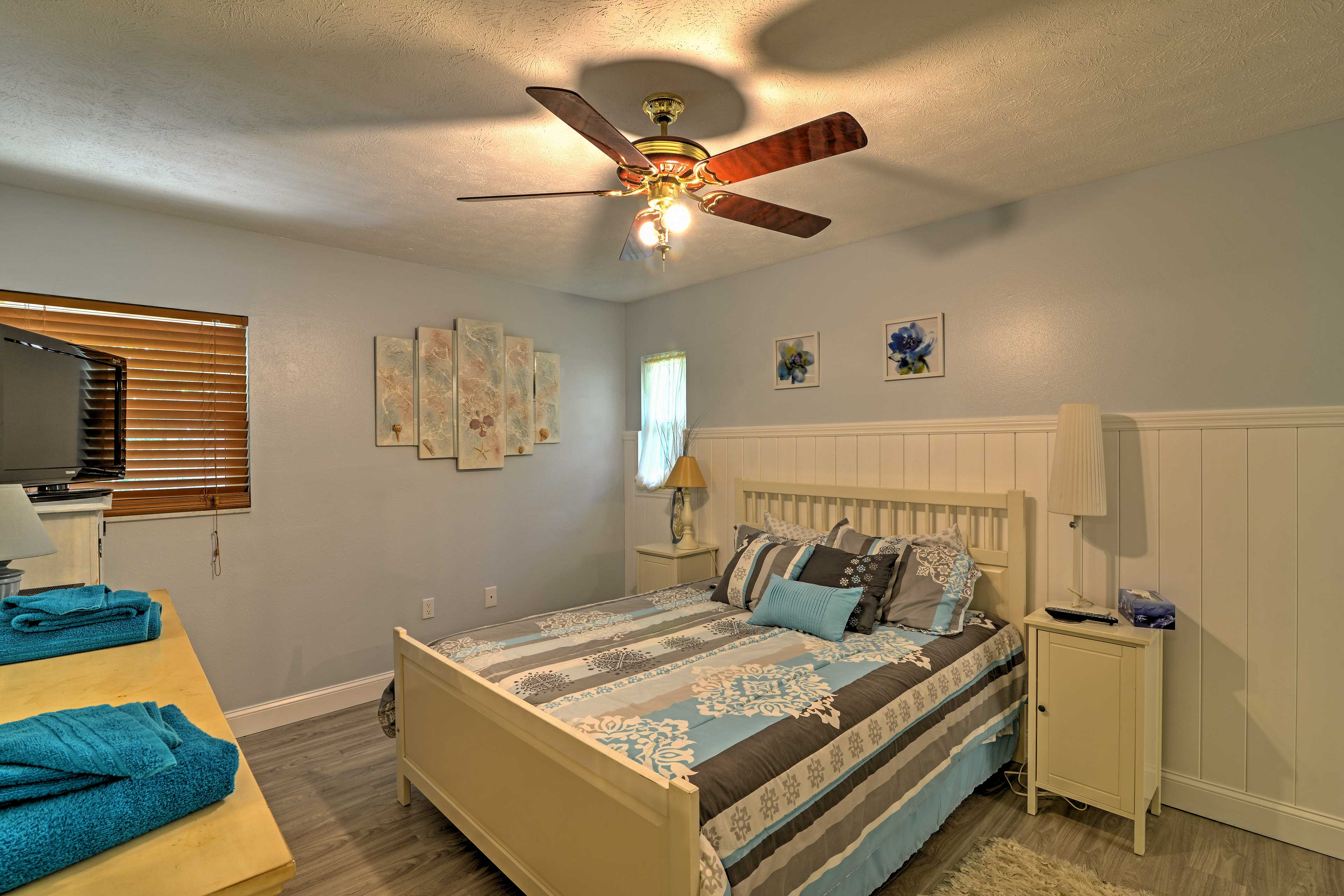 Rest your head in the master bedroom with a queen bed and flat-screen cable TV.