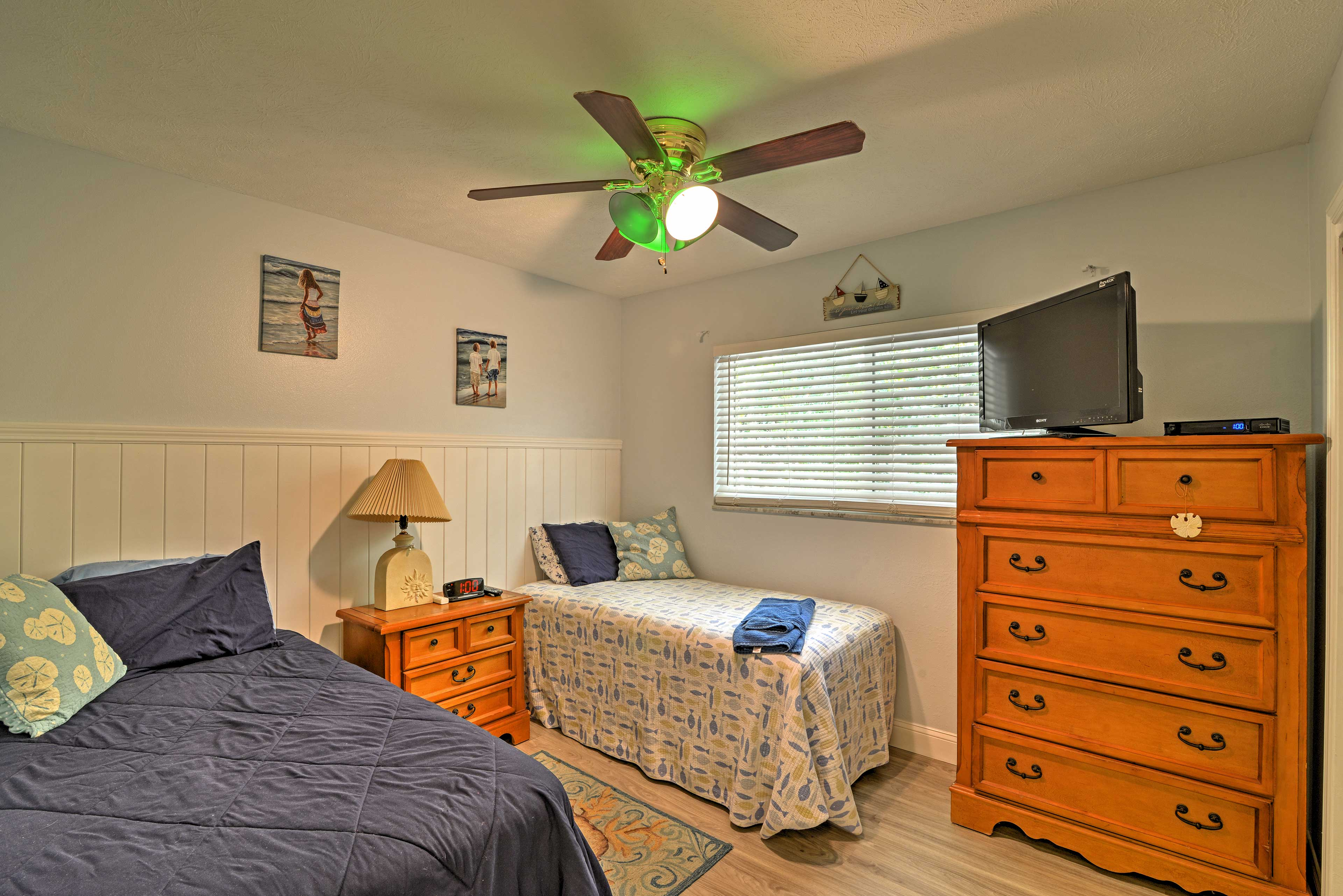 The second bedroom features 2 twin-sized beds and a flat-screen cable TV.