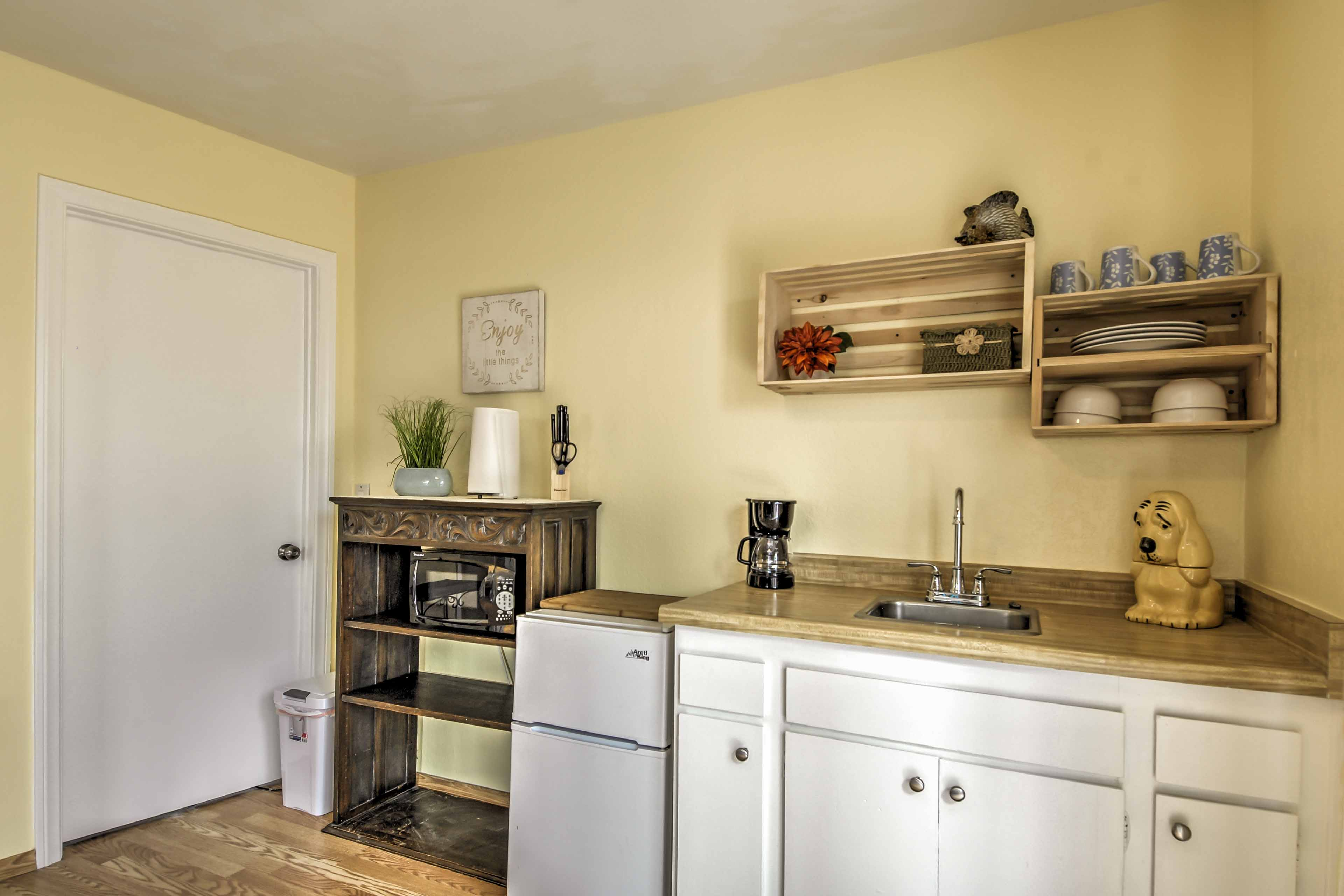 The kitchenette is equipped with a mini fridge and freezer, microwave, coffee maker and more!