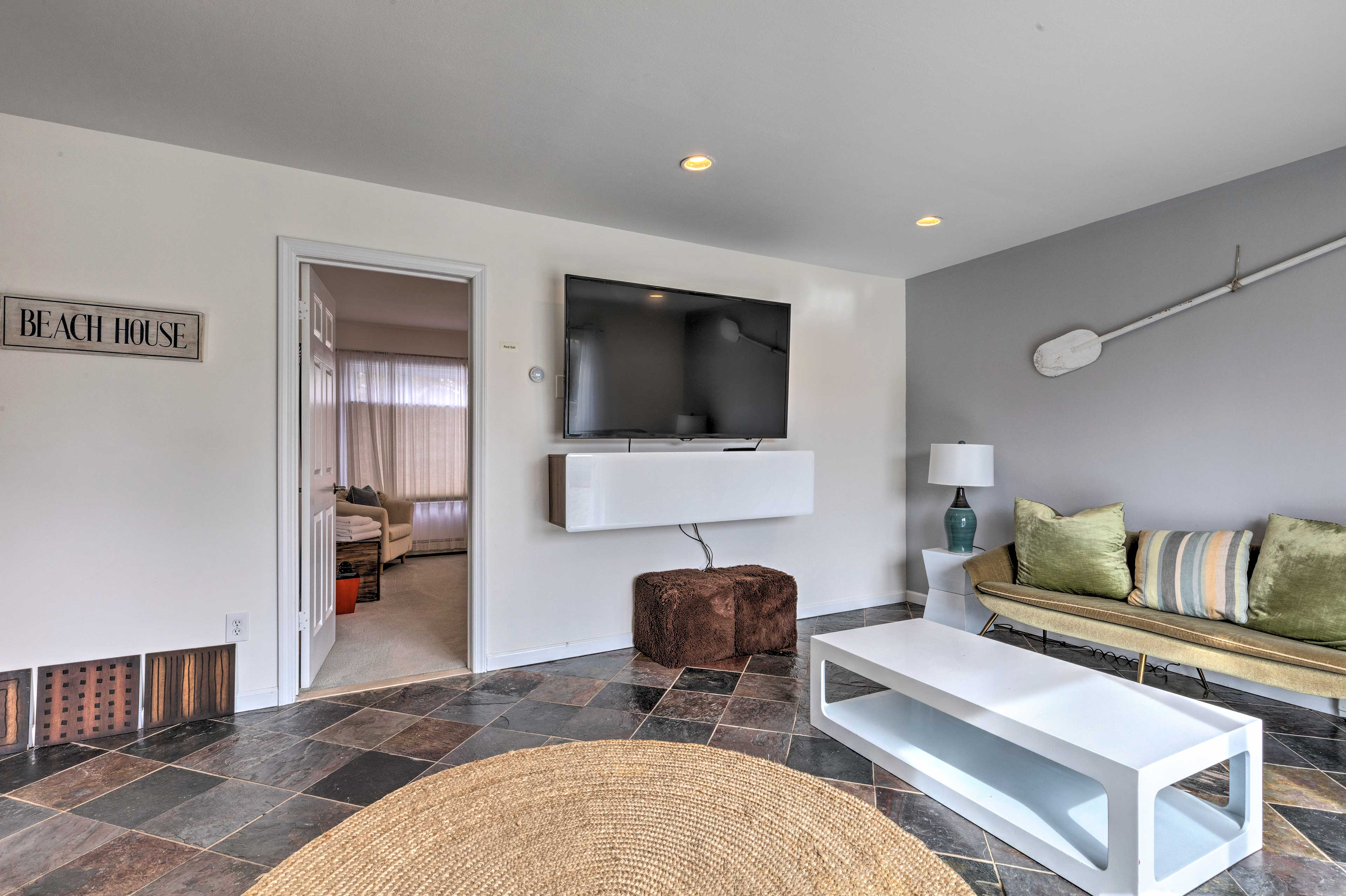 This sitting area offers a cable TV and comfy furniture.