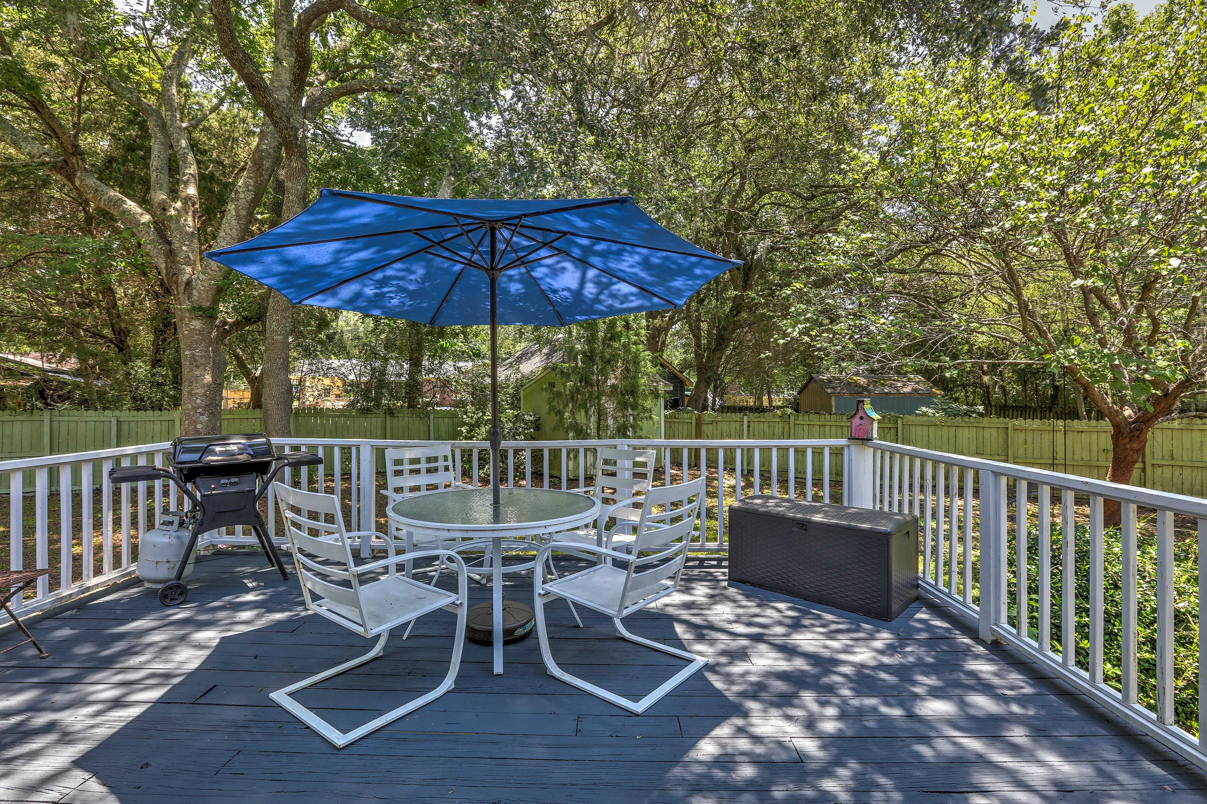 Spend your days lounging out on the back southern-style deck.