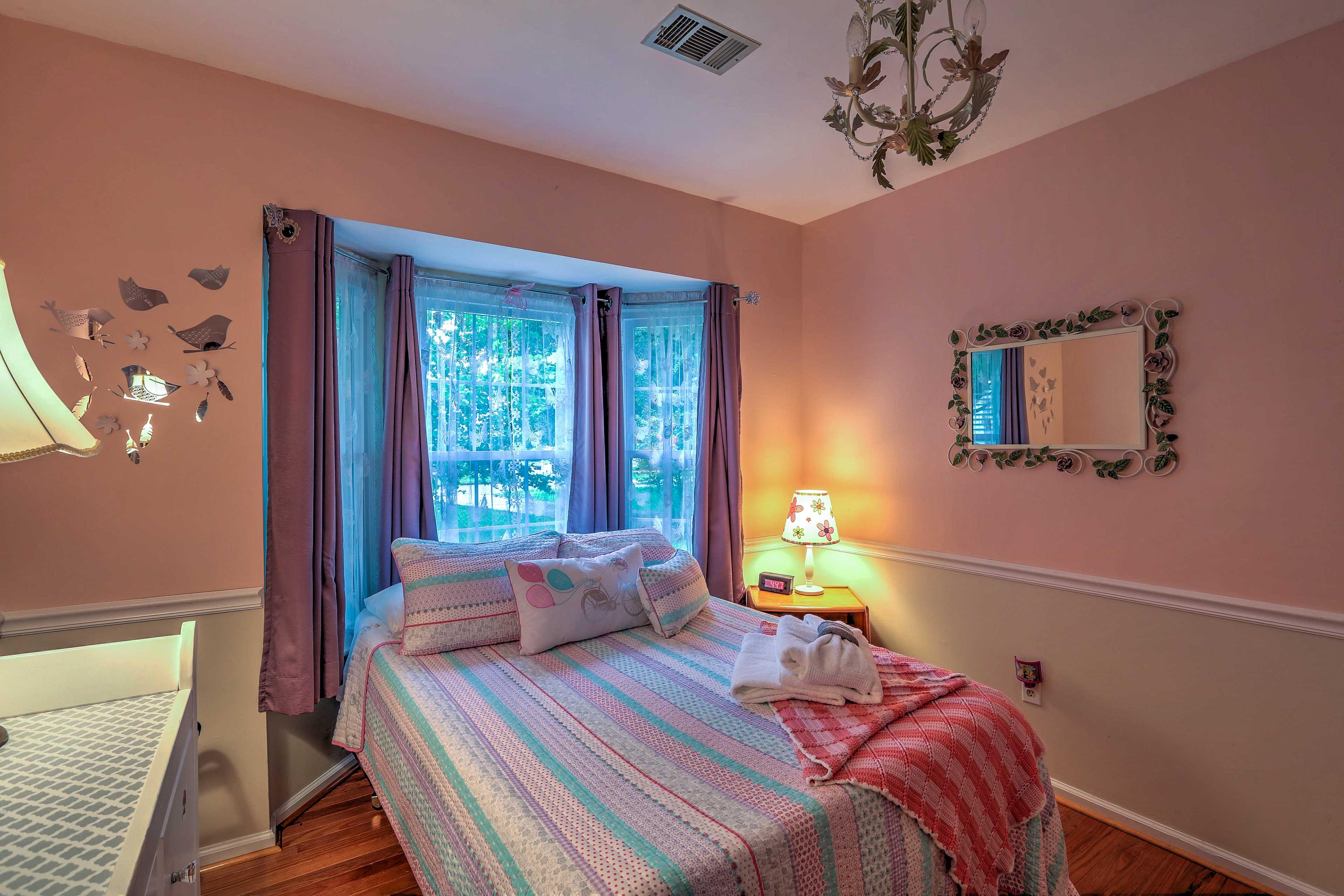 Each bedroom boasts tasteful decorations.