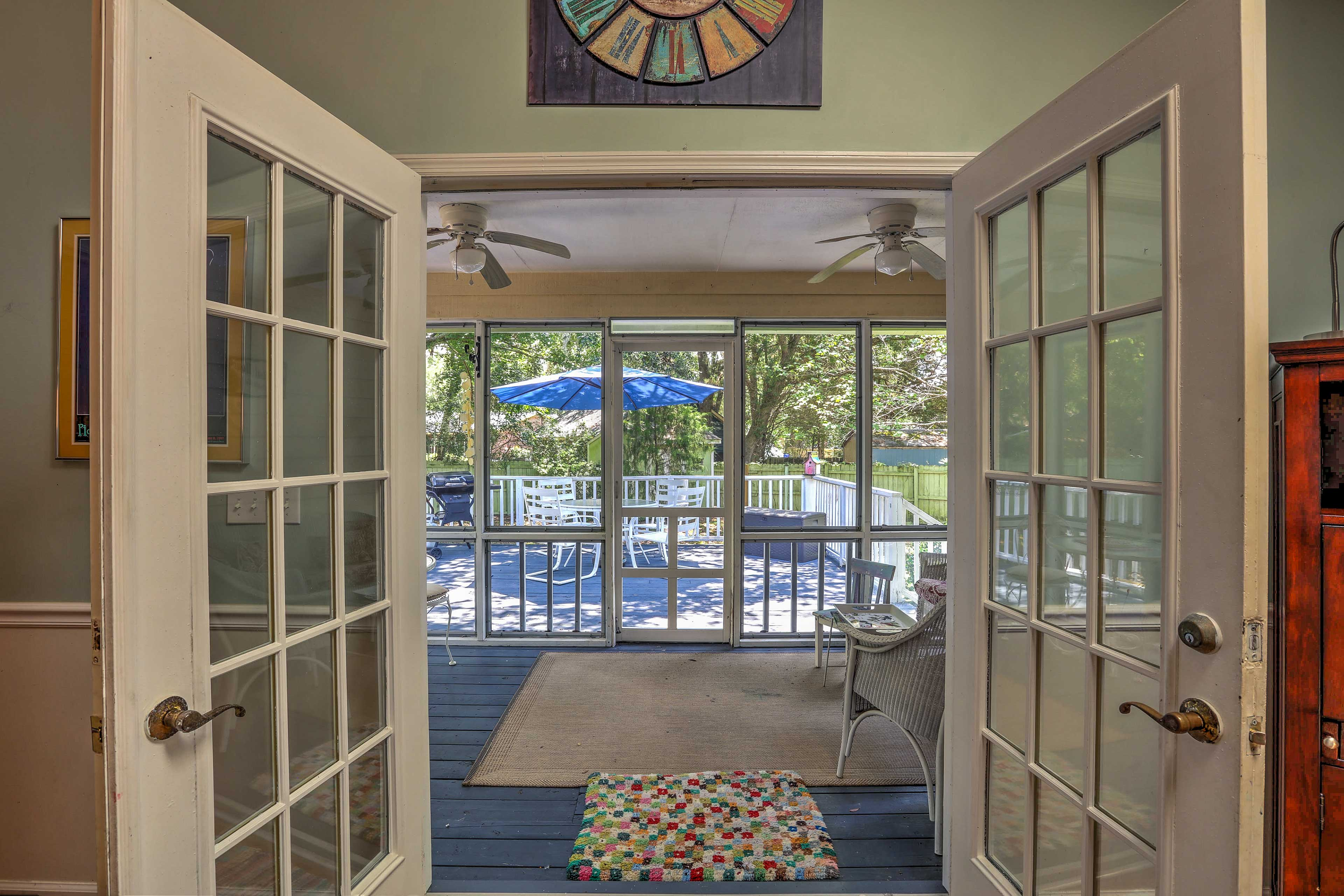 Step out to the screened porch with a hot coffee to catch the morning sunrise.