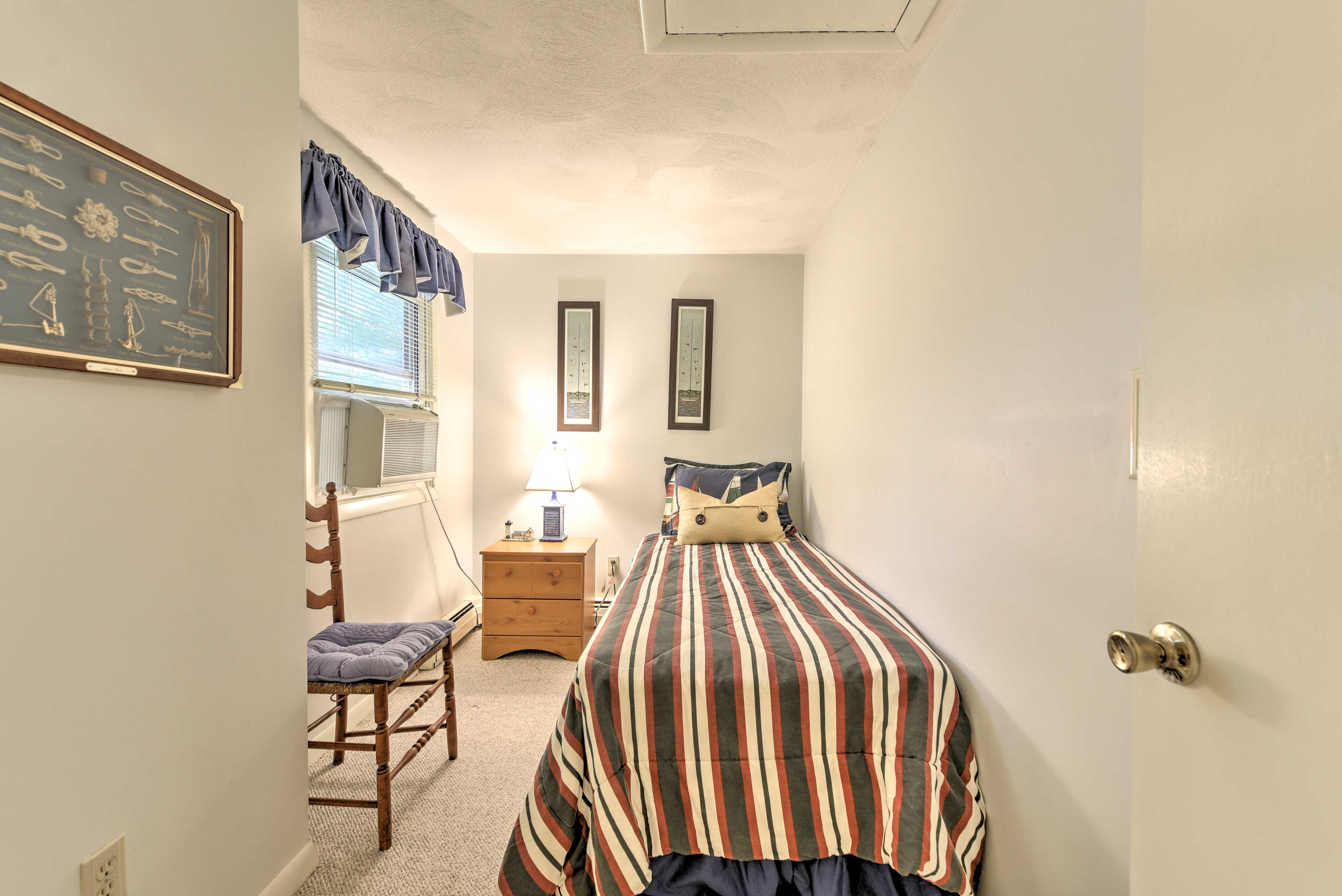 Sweet dreams await on this quaint twin bed!