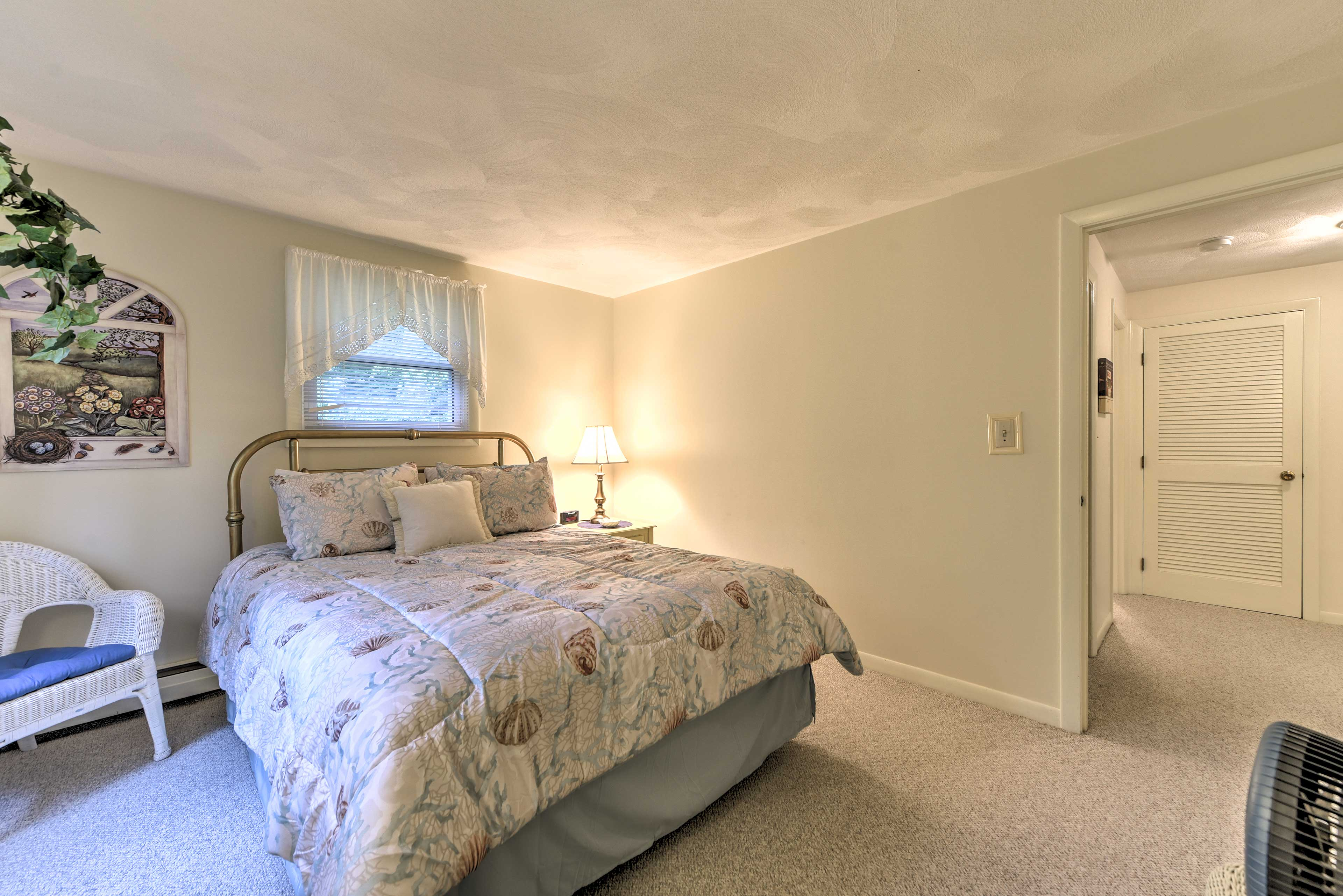 Those sharing this bedroom will relish in restful nights of sleep in the queen.