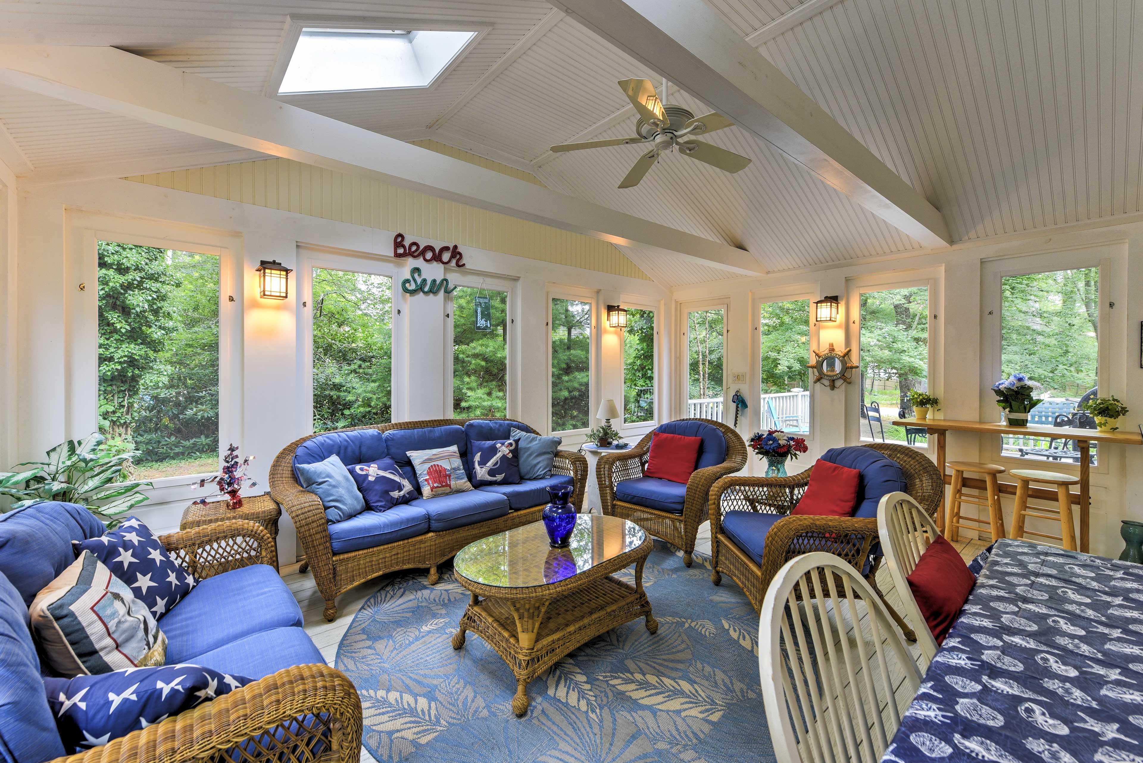 The beautiful sunroom provides fabulous views of the surrounding greenery.