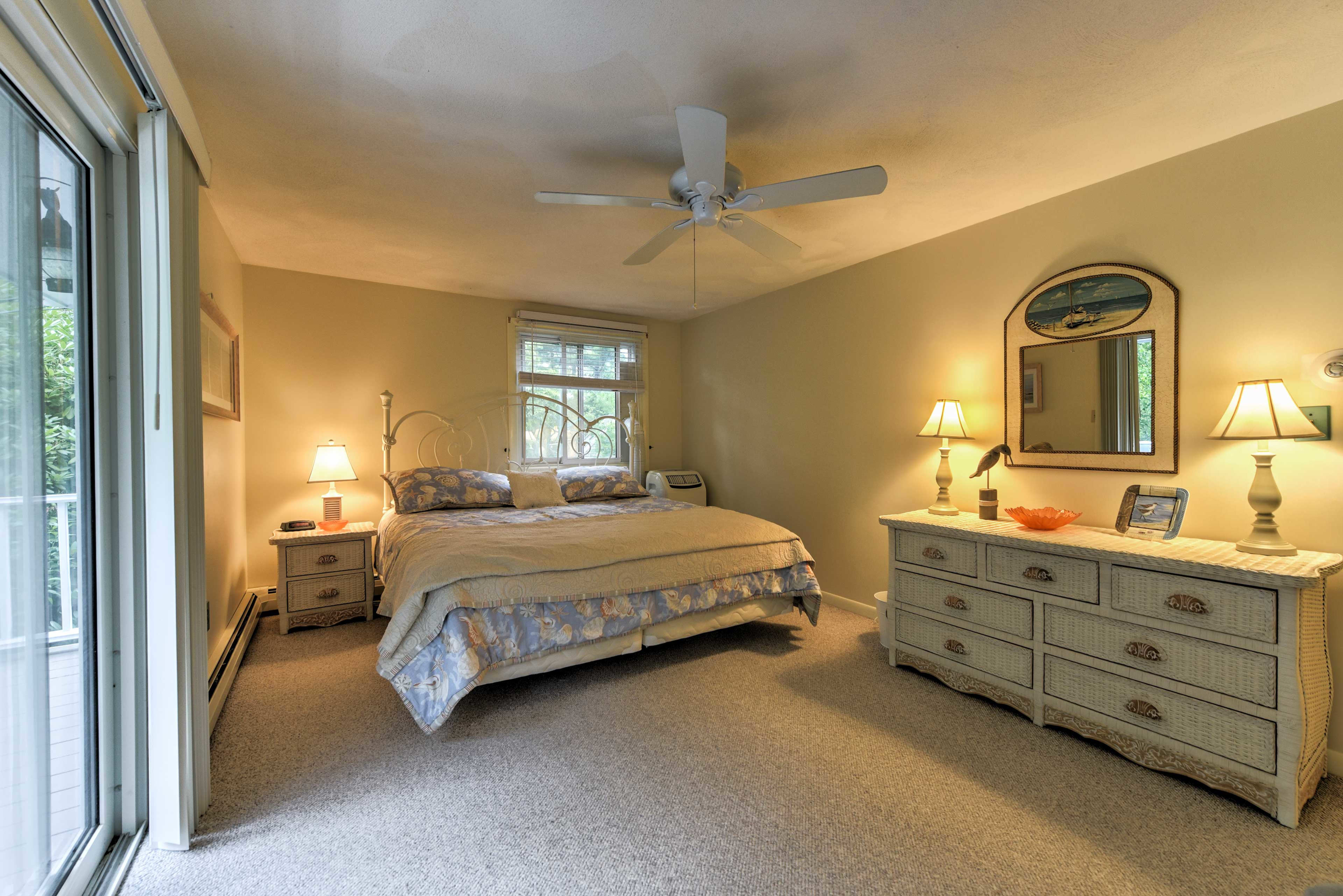 The master bedroom features a king bed and direct access to the balcony.