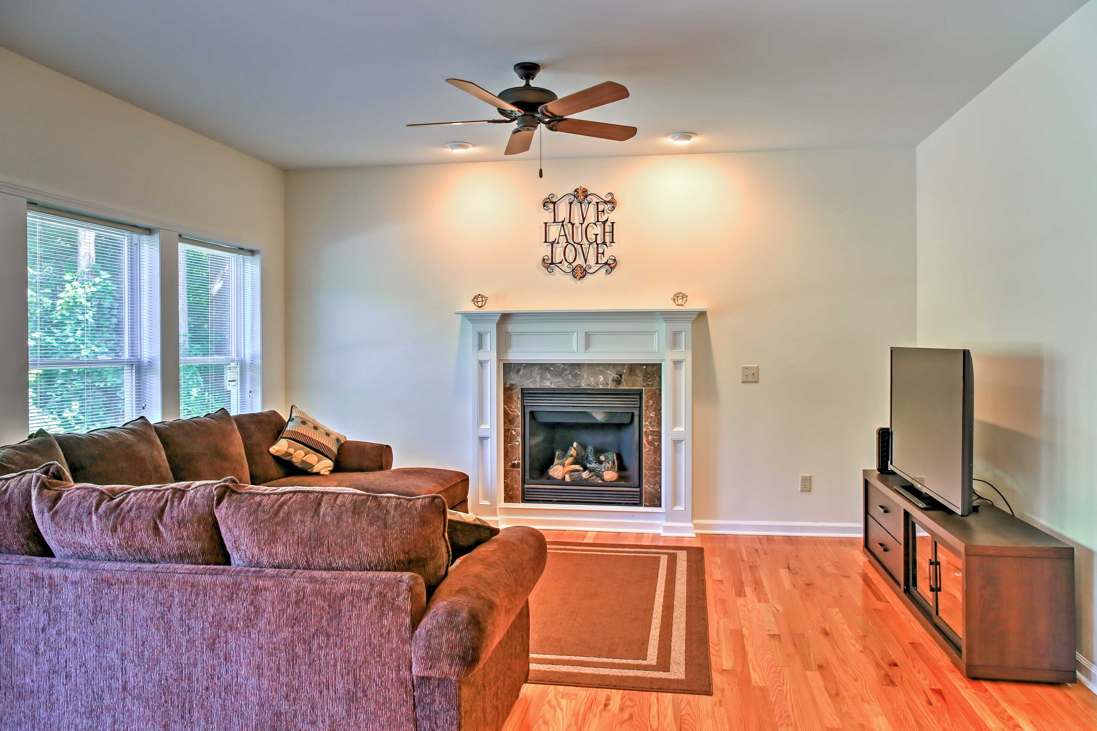 Cozy up in the den area with a fireplace and 55-inch flat-screen TV.