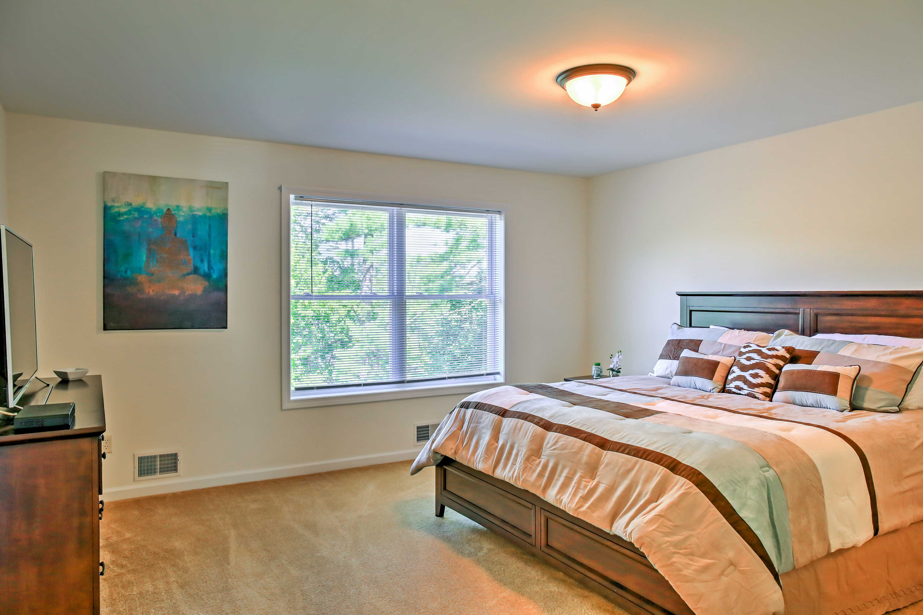 The master bedroom boasts a king bed, flat-screen TV and en-suite bathroom.