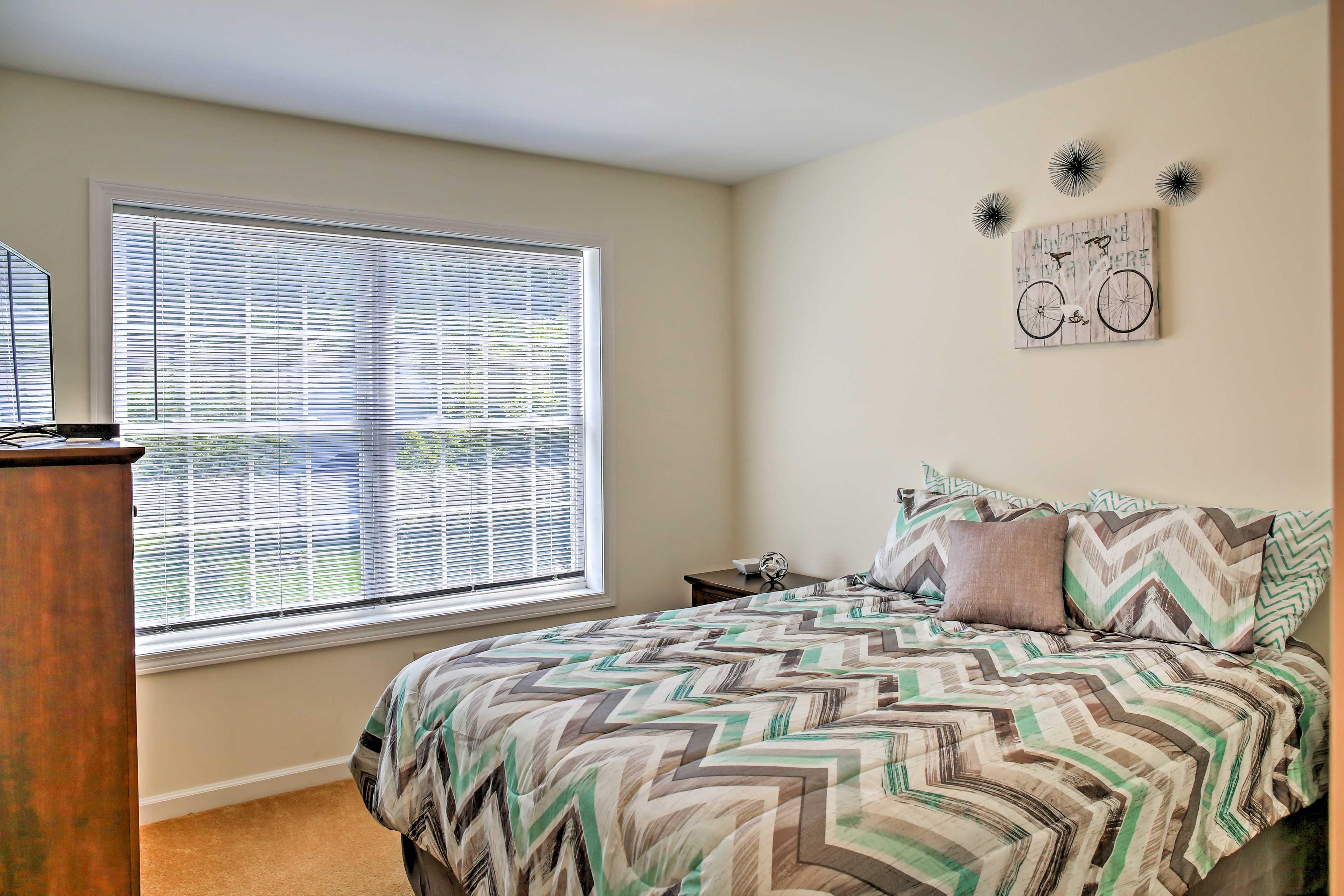 This bedroom offers a comfortable queen bed and flat-screen TV.