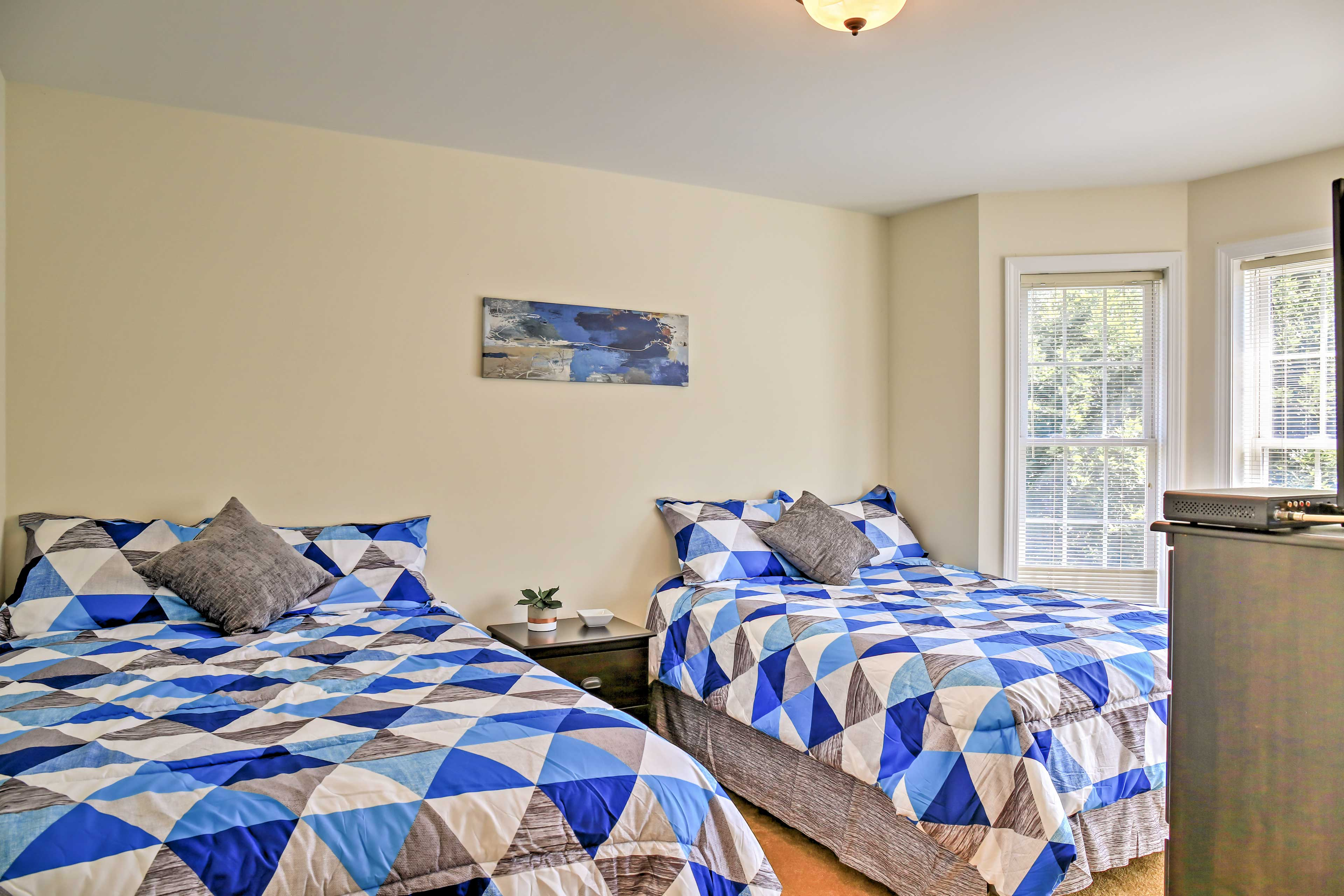 Two full beds can accommodate 4 guests.