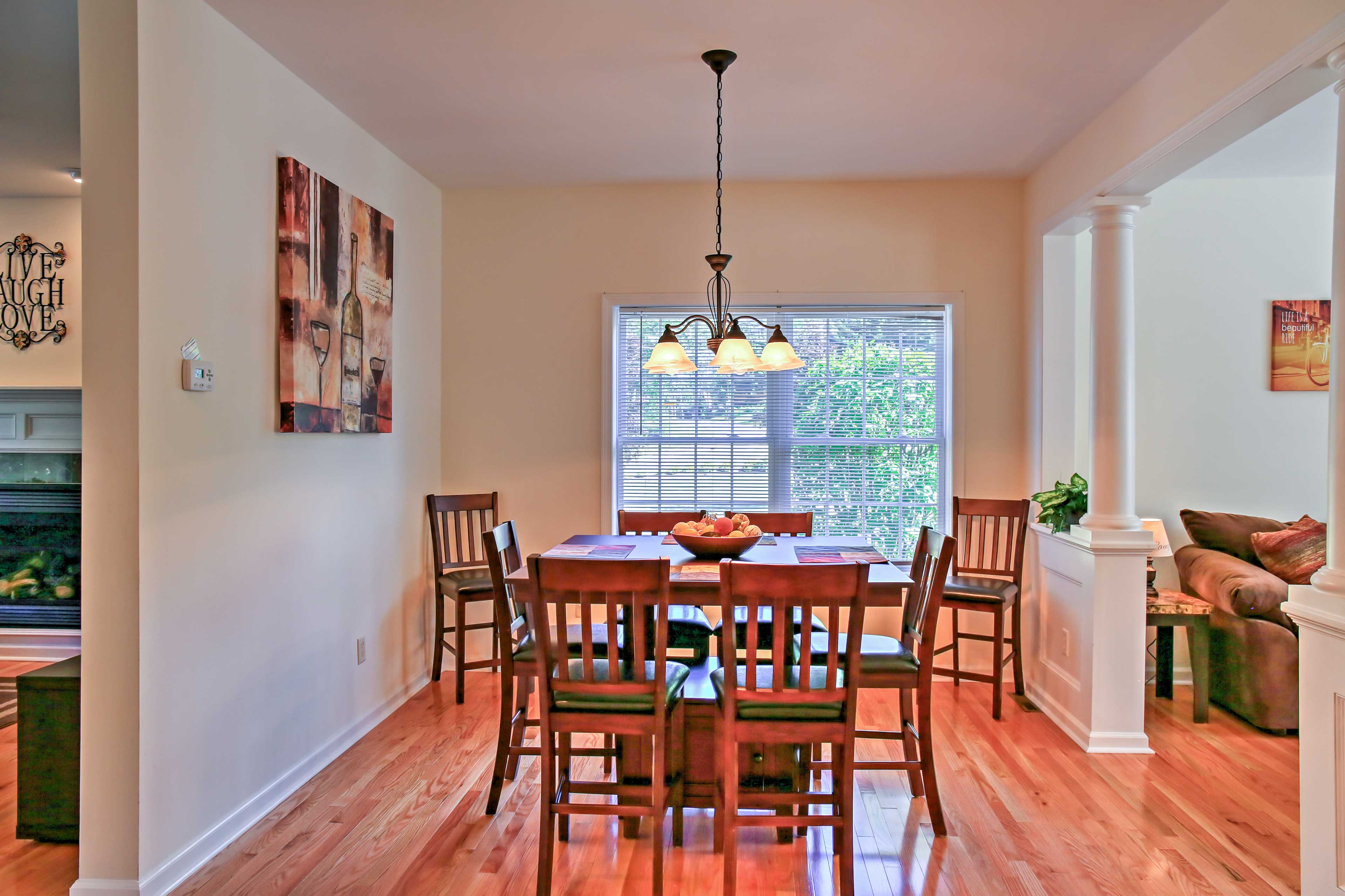 Share home-cooked meals at the elegant dining table with room for 8.