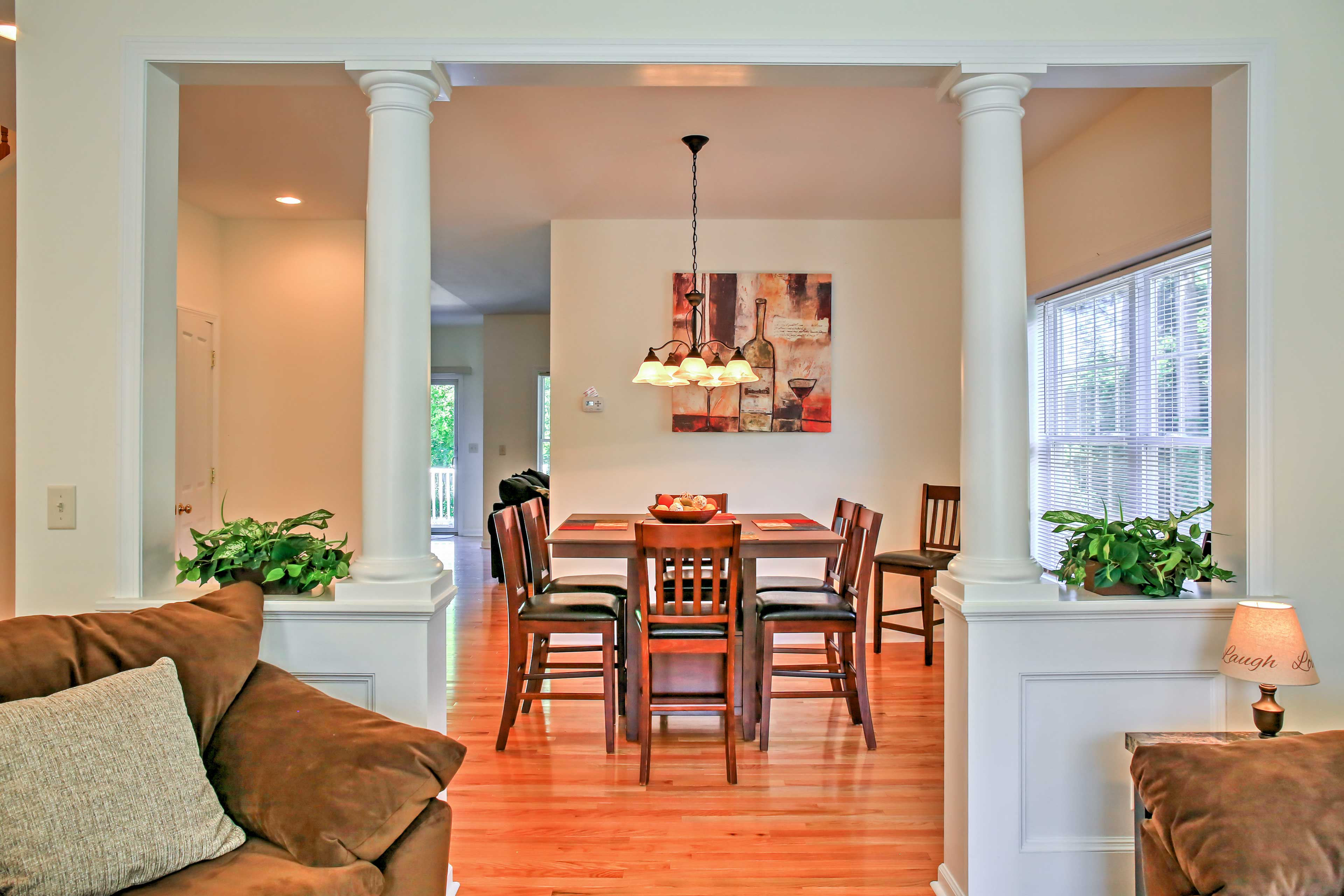 A formal dining area separates the 2 main living rooms.