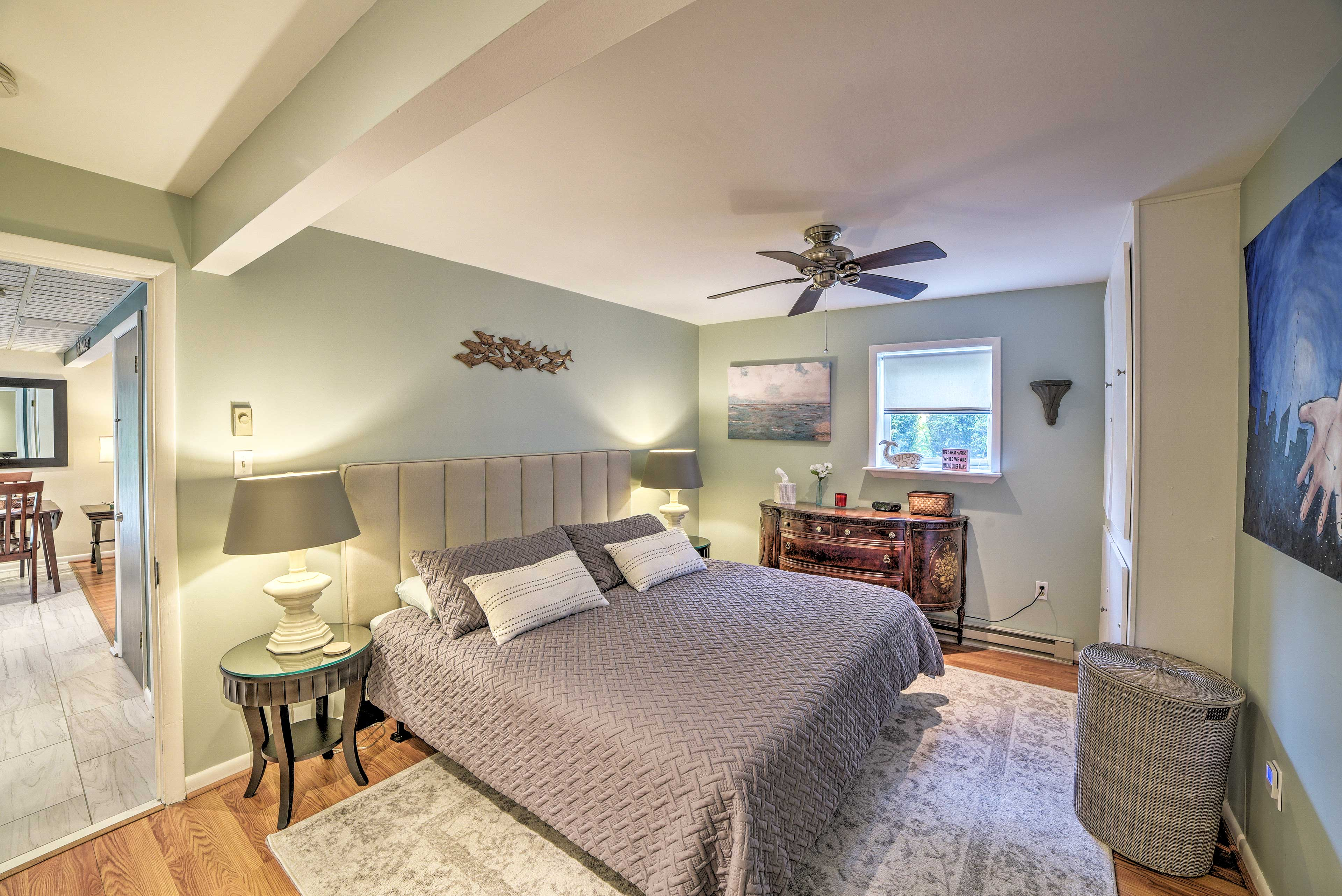 The bedroom hosts a king bed.