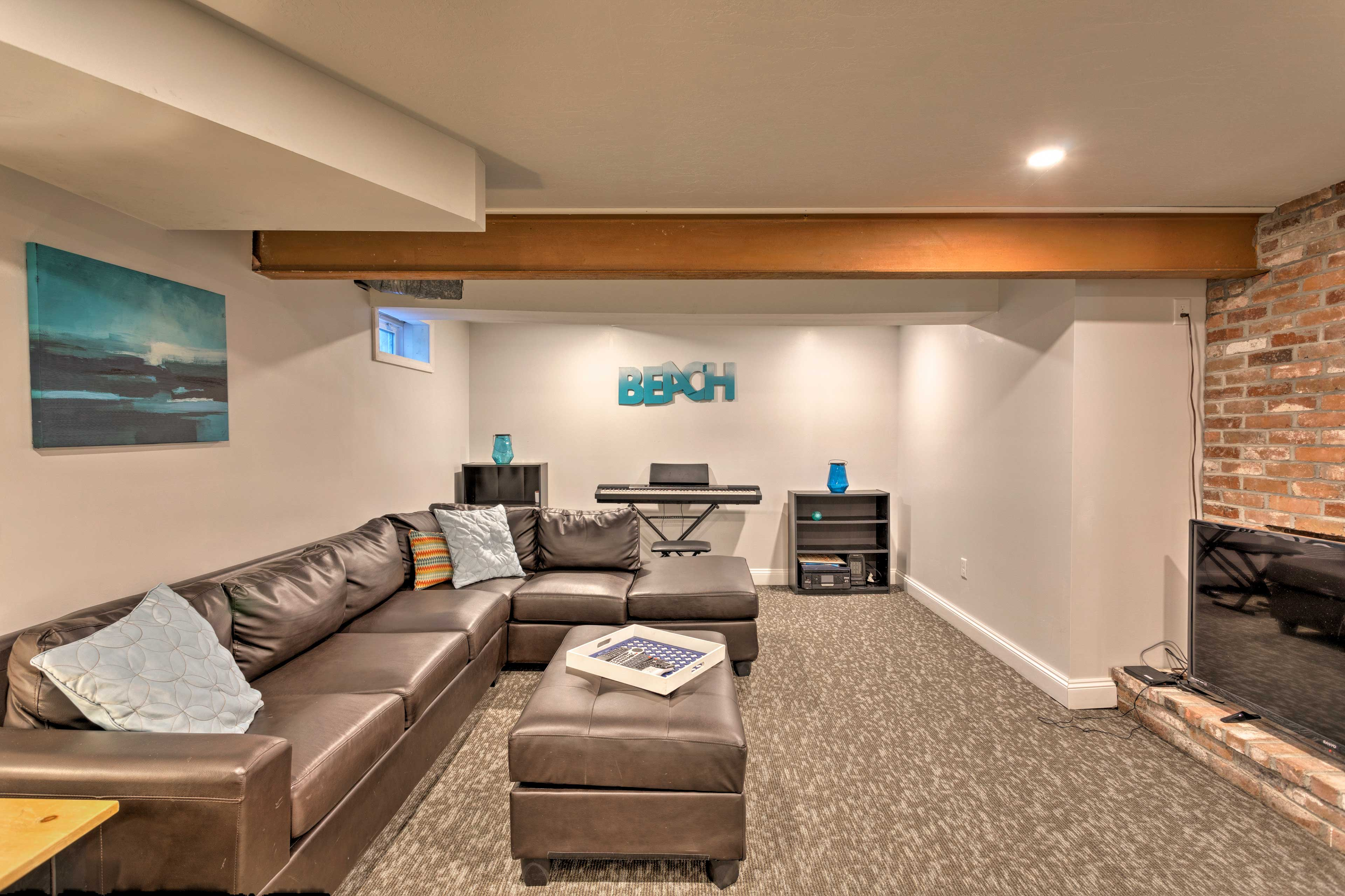 The basement is the perfect spot to relax with your whole family.