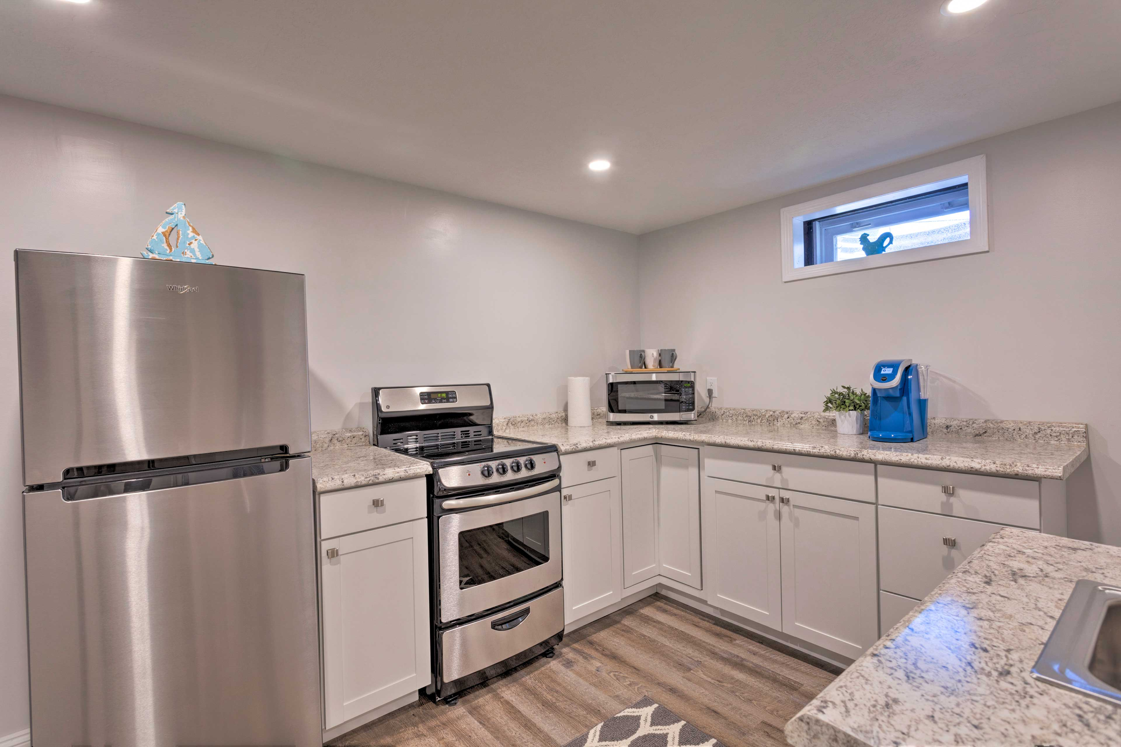 The basement has a kitchenette with new appliances.