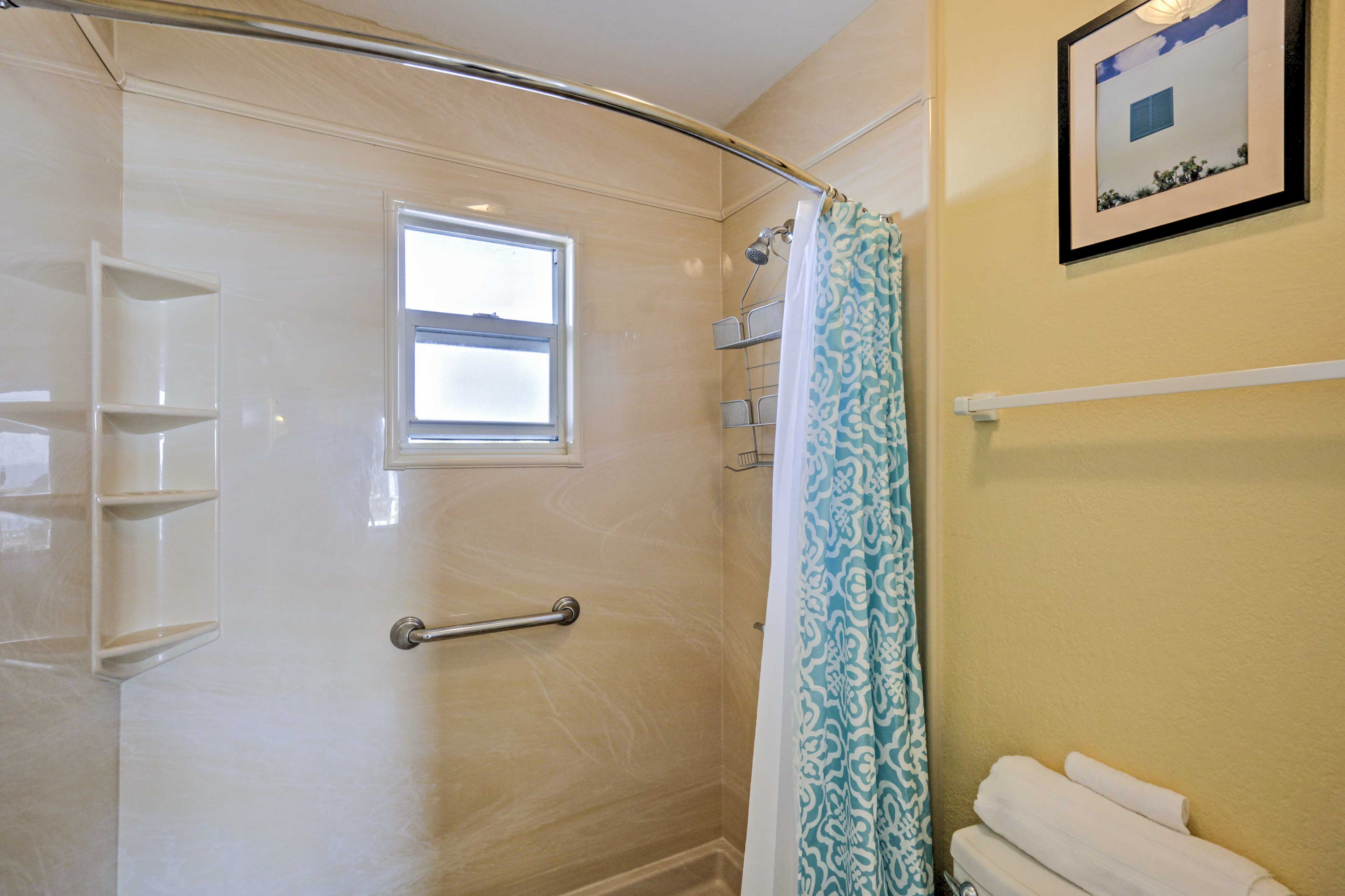 The bathroom features a walk-in shower.