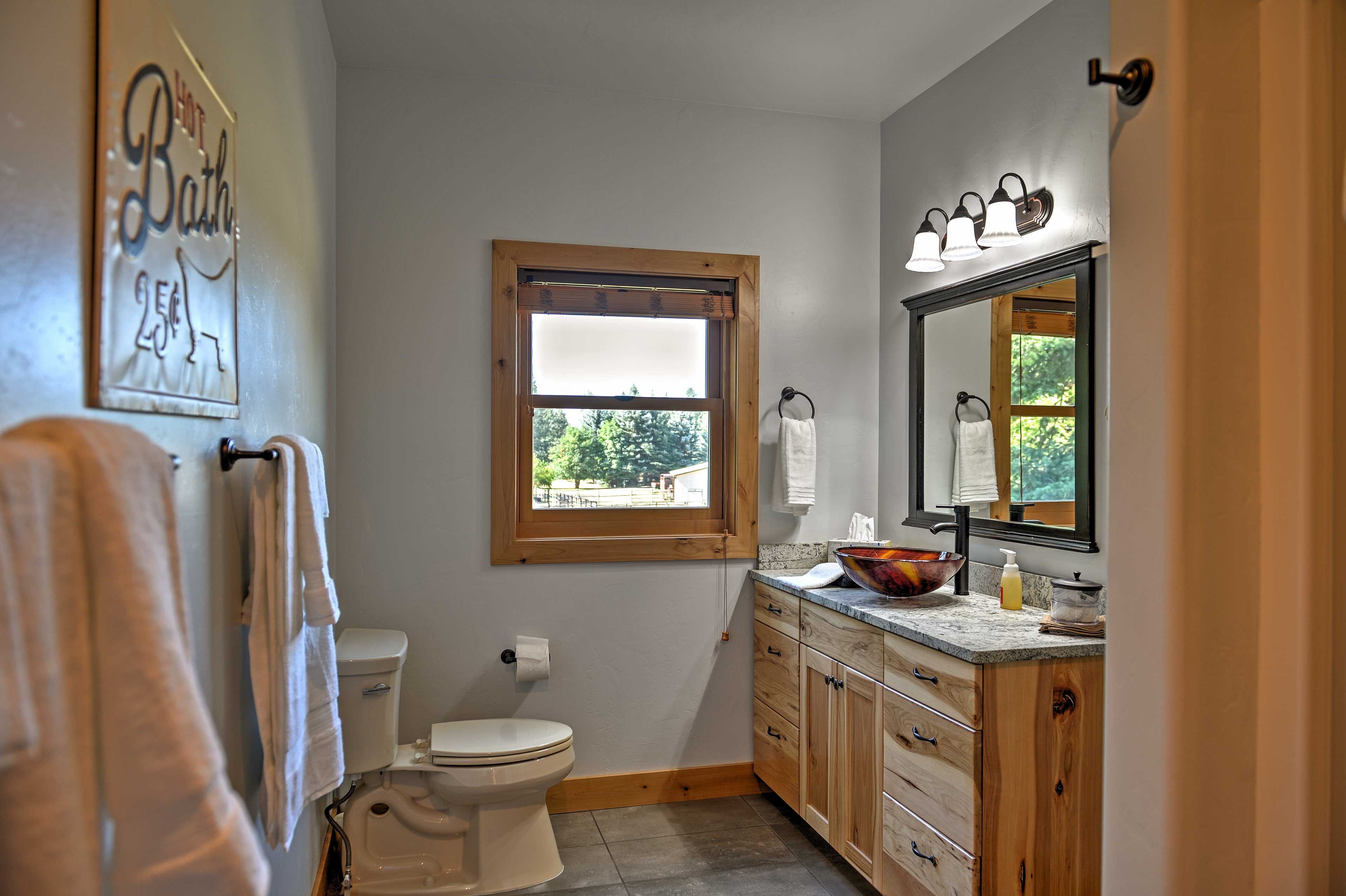 The bathroom features a stylish vessel sink.