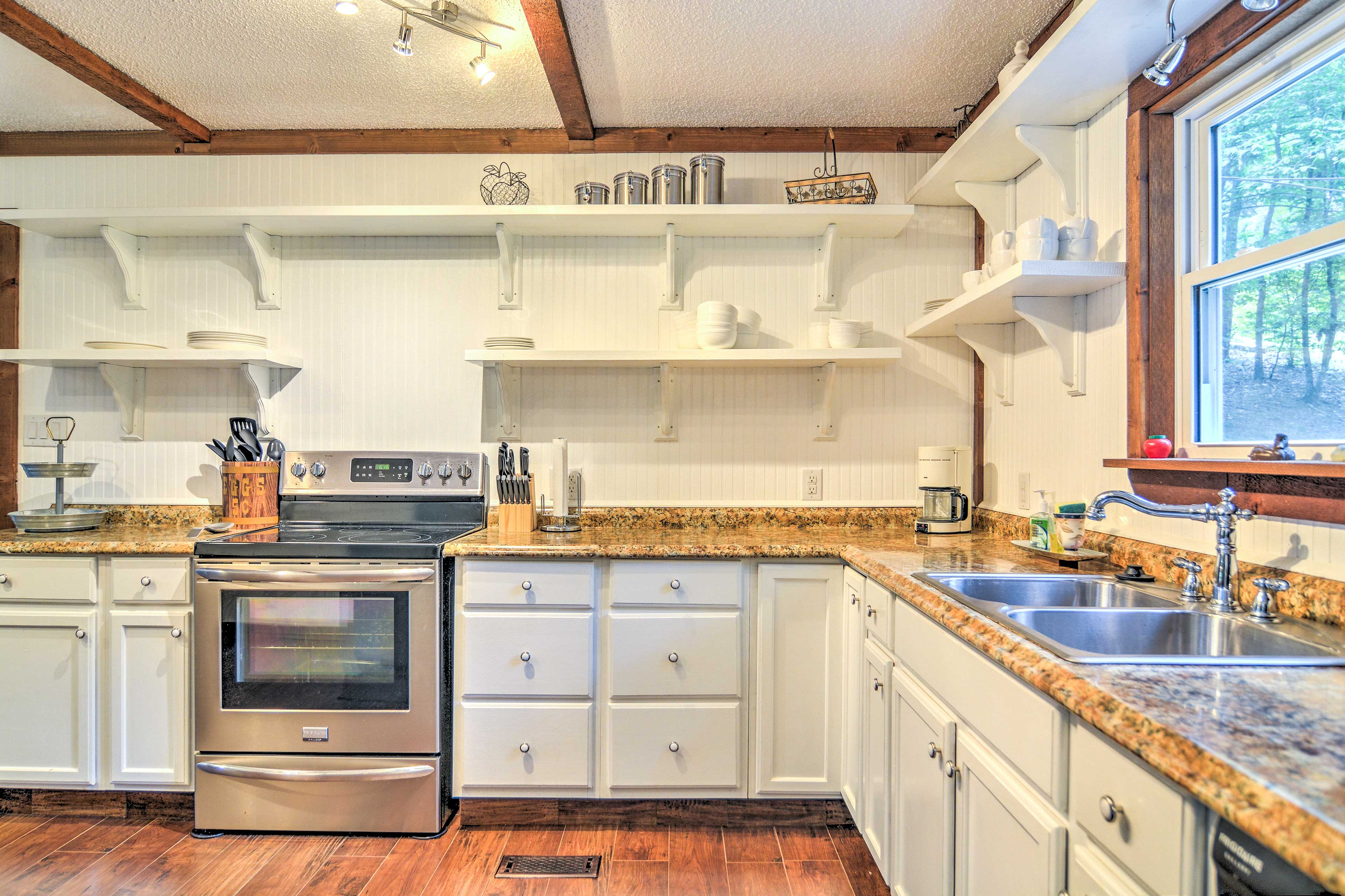 The kitchen features stainless steel appliances and beautiful countertops.