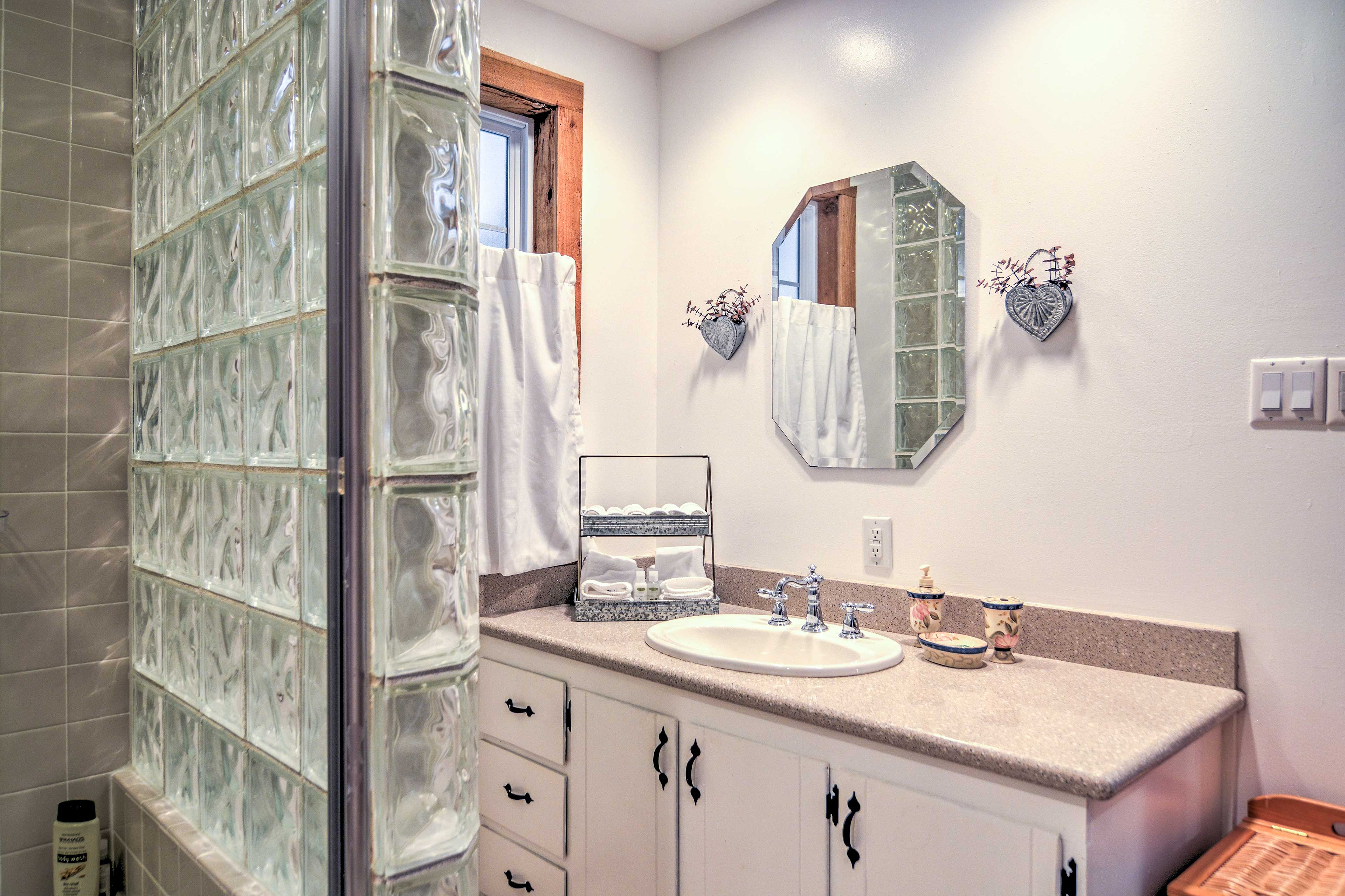 The first bathroom features new fixtures and appliances.