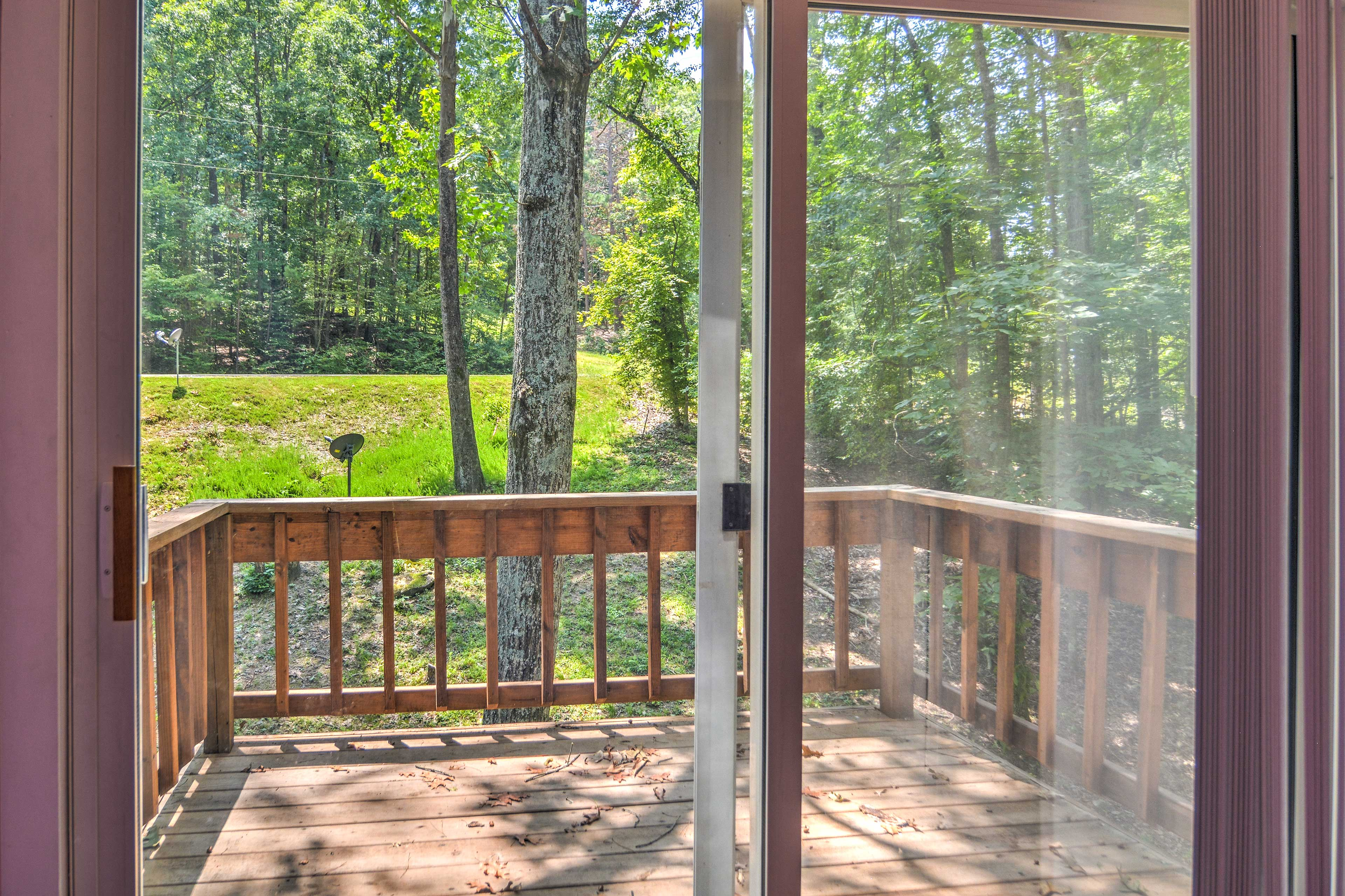 An upstairs balcony looks out upon the dense forest.