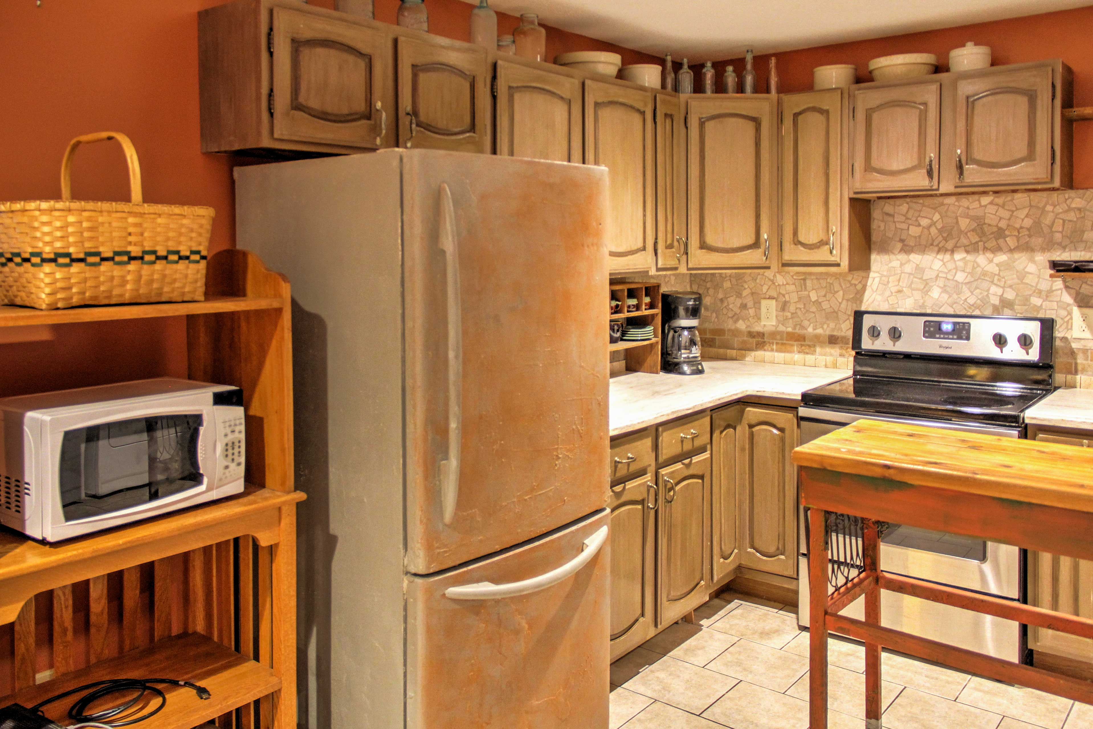 The kitchen includes all your essential appliances and a high-top table.